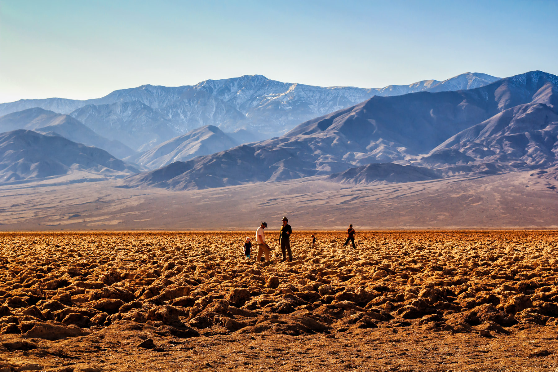 Tourists at The Devil's Golf Course, Death Valley, California.