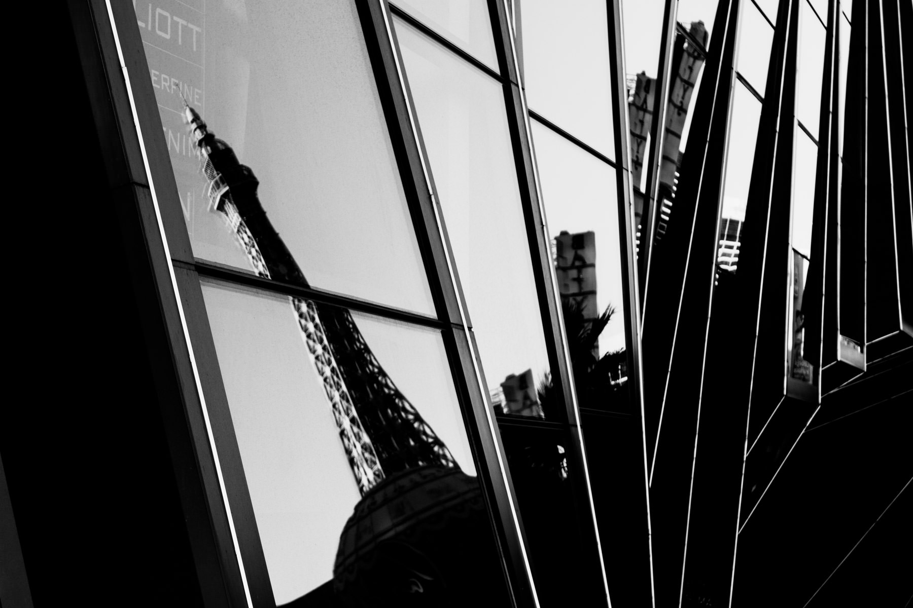 Paris Hotel & Casino's faux Eiffel Tower reflected in the glass facade of the Cosmopolitan of Las Vegas.