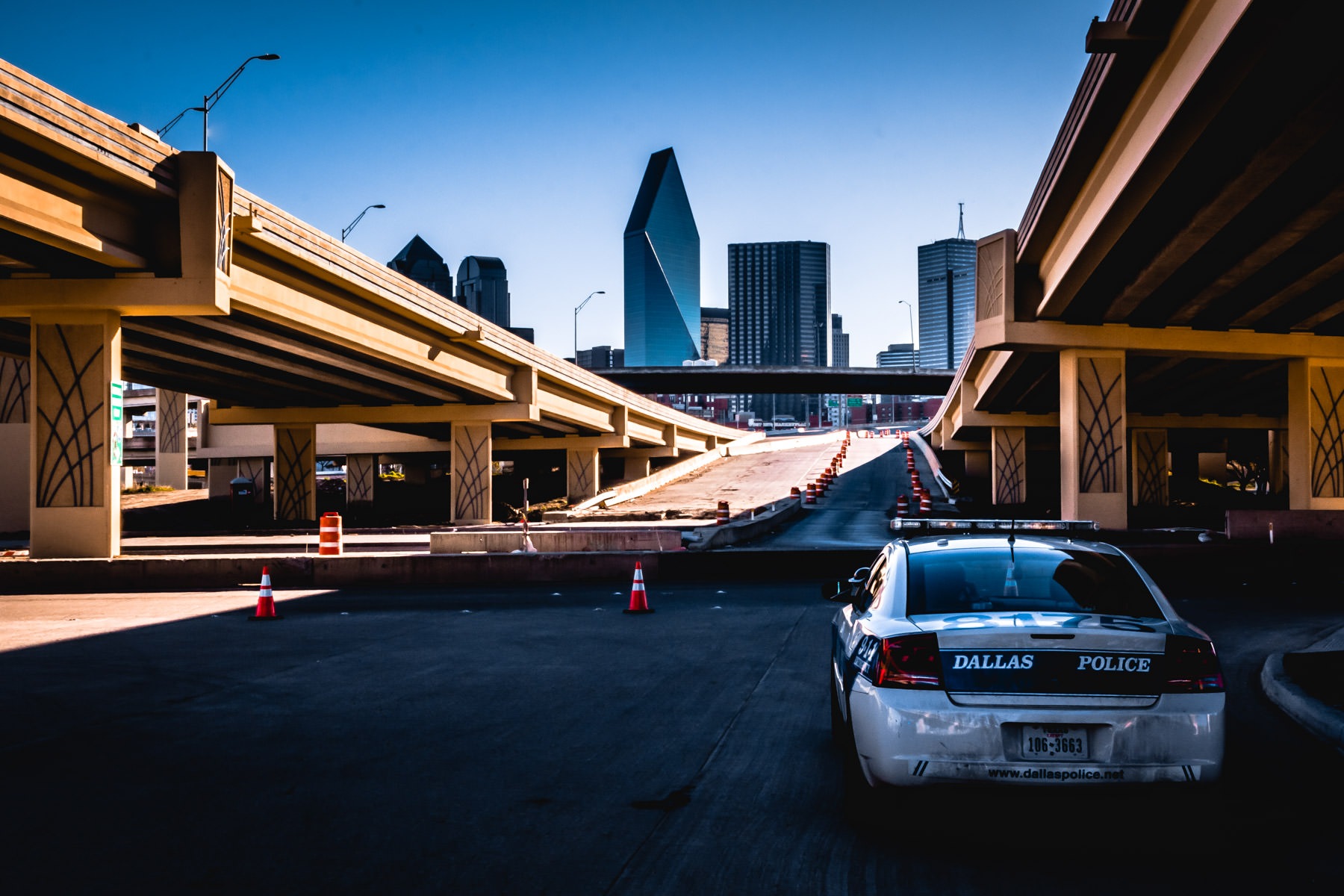 A Dallas police cruiser parked between the approach ramps to the Santiago Calatrava-designed Margaret Hunt Hill Bridge during its 2012 dedication ceremony.