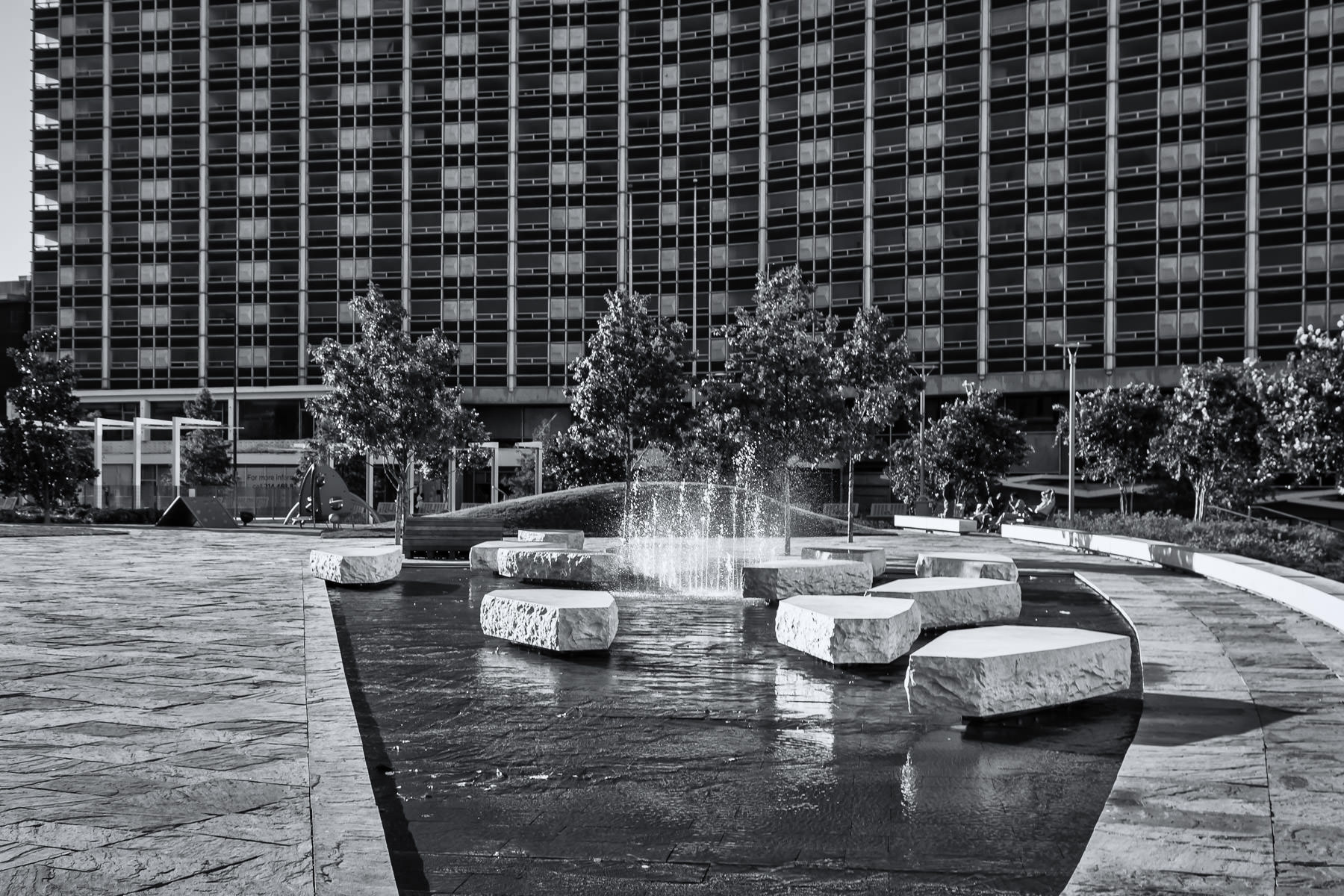 The long-abandoned yet soon-to-be-reborn Dallas Grand Hotel (formerly known as the Statler Hilton) looms over Main Street Garden in Downtown Dallas.
