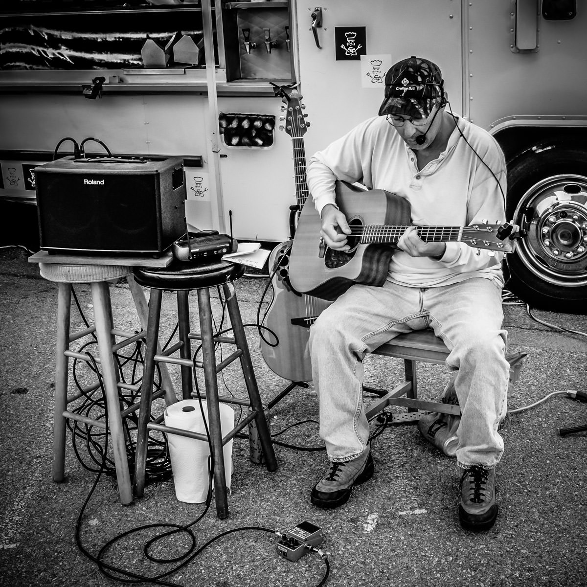 A musician plays his guitar at the Dallas Food Truck Festival.