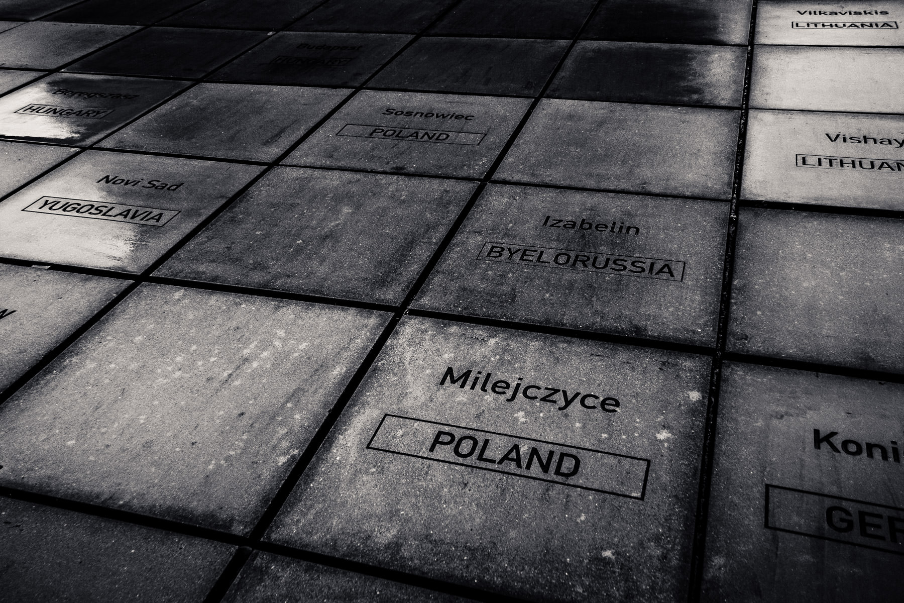 This concrete slab outside the Houston Holocaust Museum is inscribed with the names of destroyed Jewish communities of Europe.