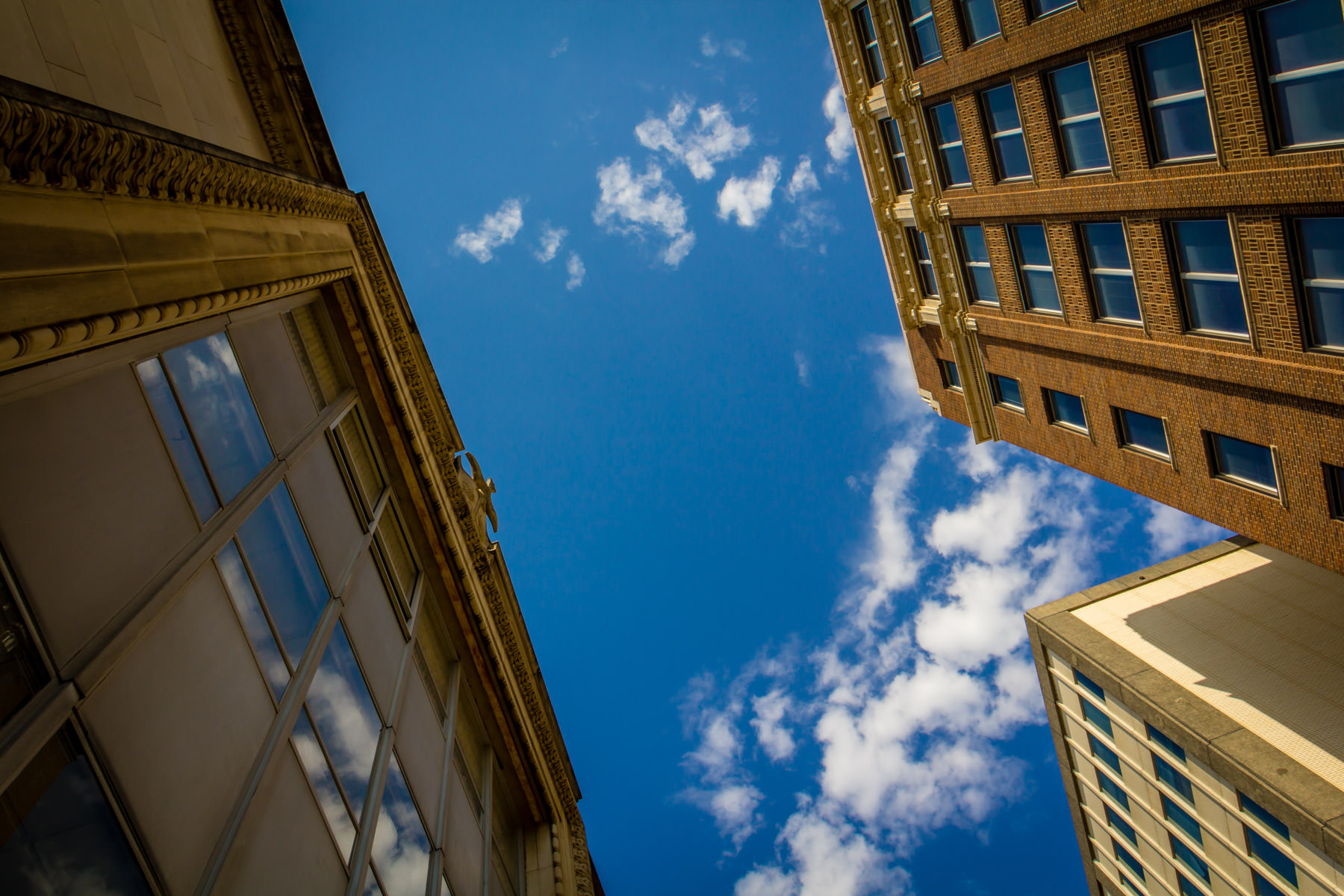 A sliver of blue sky cuts between two buildings in Downtown Dallas.