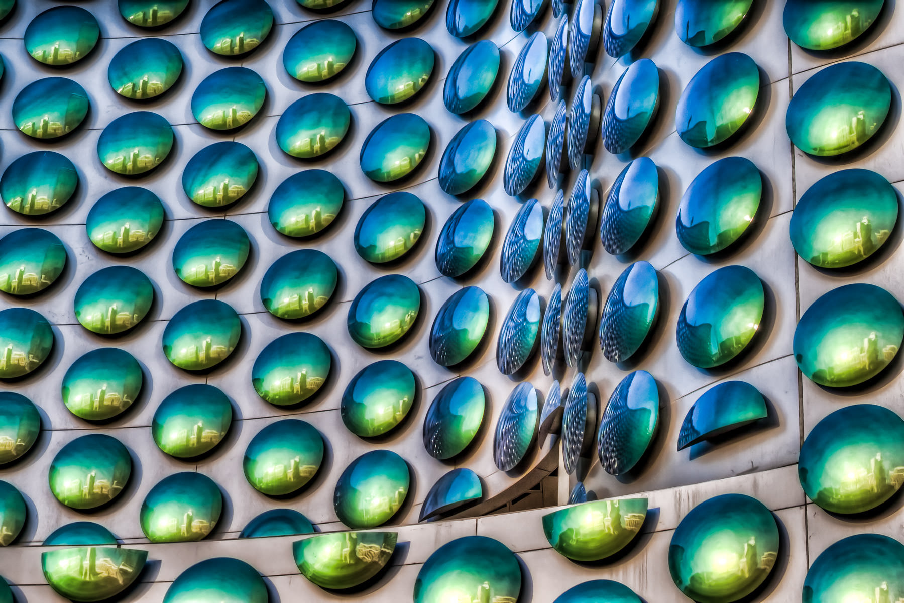Exterior detail of Las Vegas' Planet Hollywood Casino & Hotel.  Each features a reflection of its across-the-street neighbor, The Bellagio.