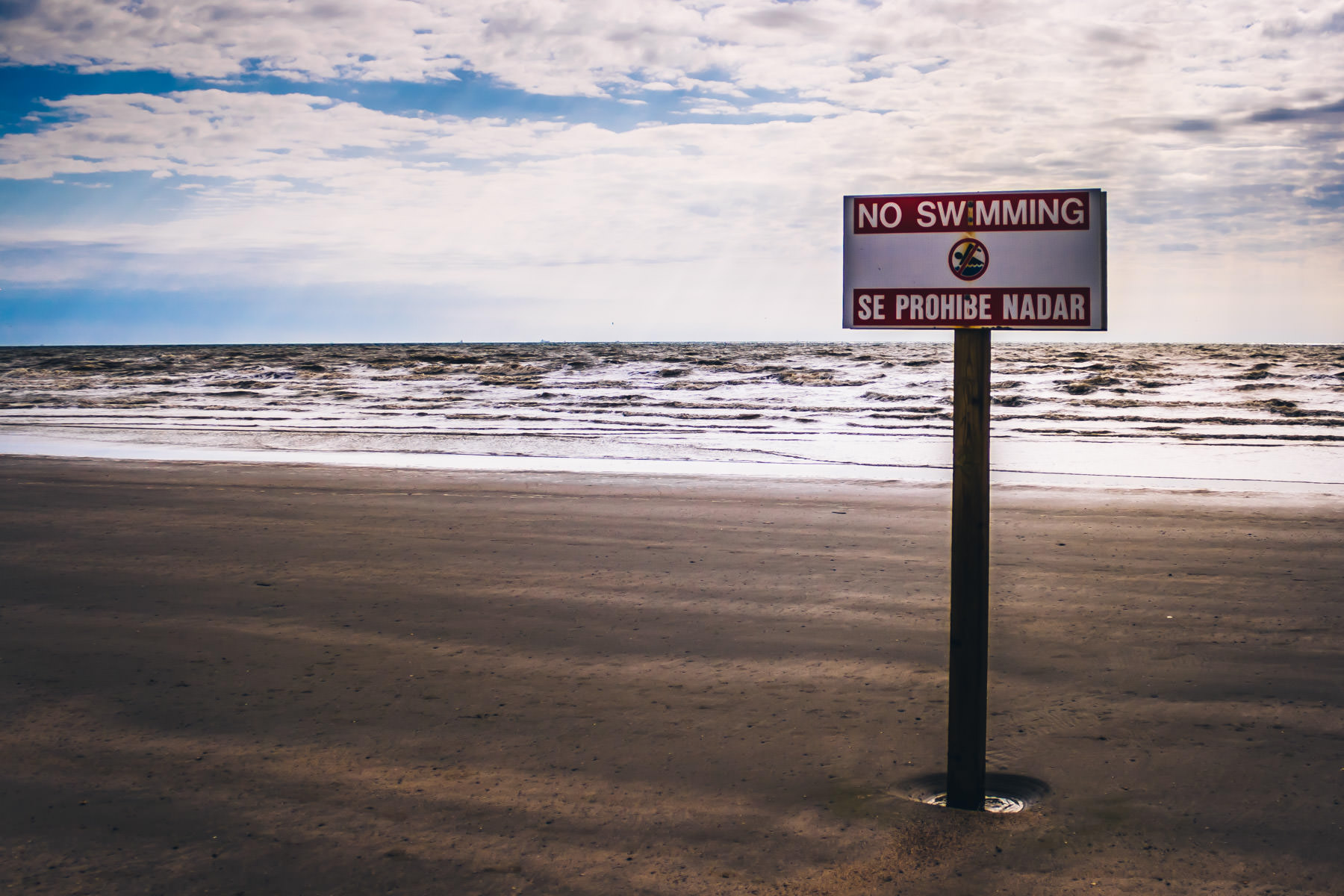 A warning sign on a Galveston, Texas beach.
