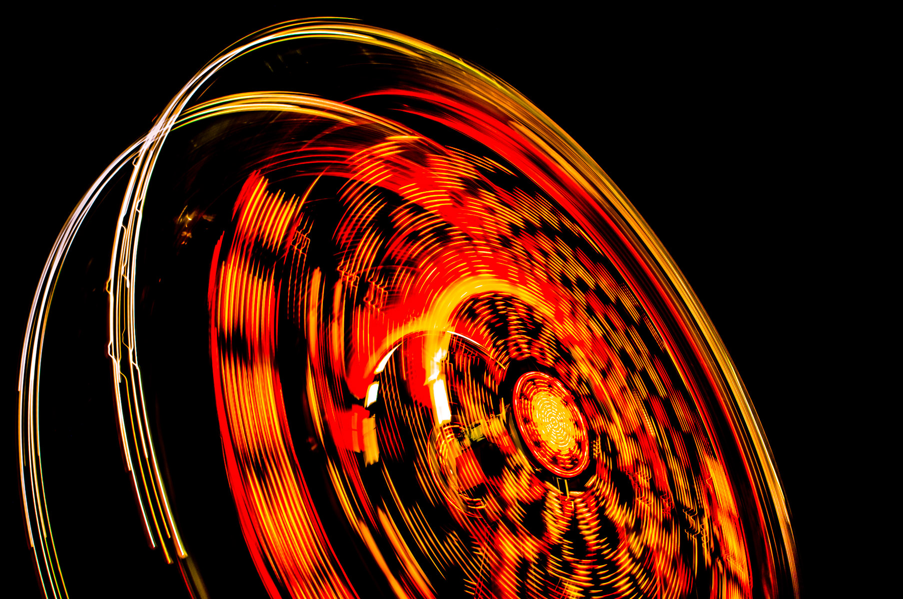 A long exposure shot of a dizzying carnival ride at Addison Oktoberfest, Addison, Texas.
