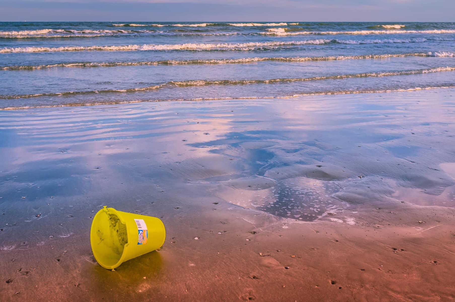 A lonely sand bucket on the Galveston Island, Texas beach.