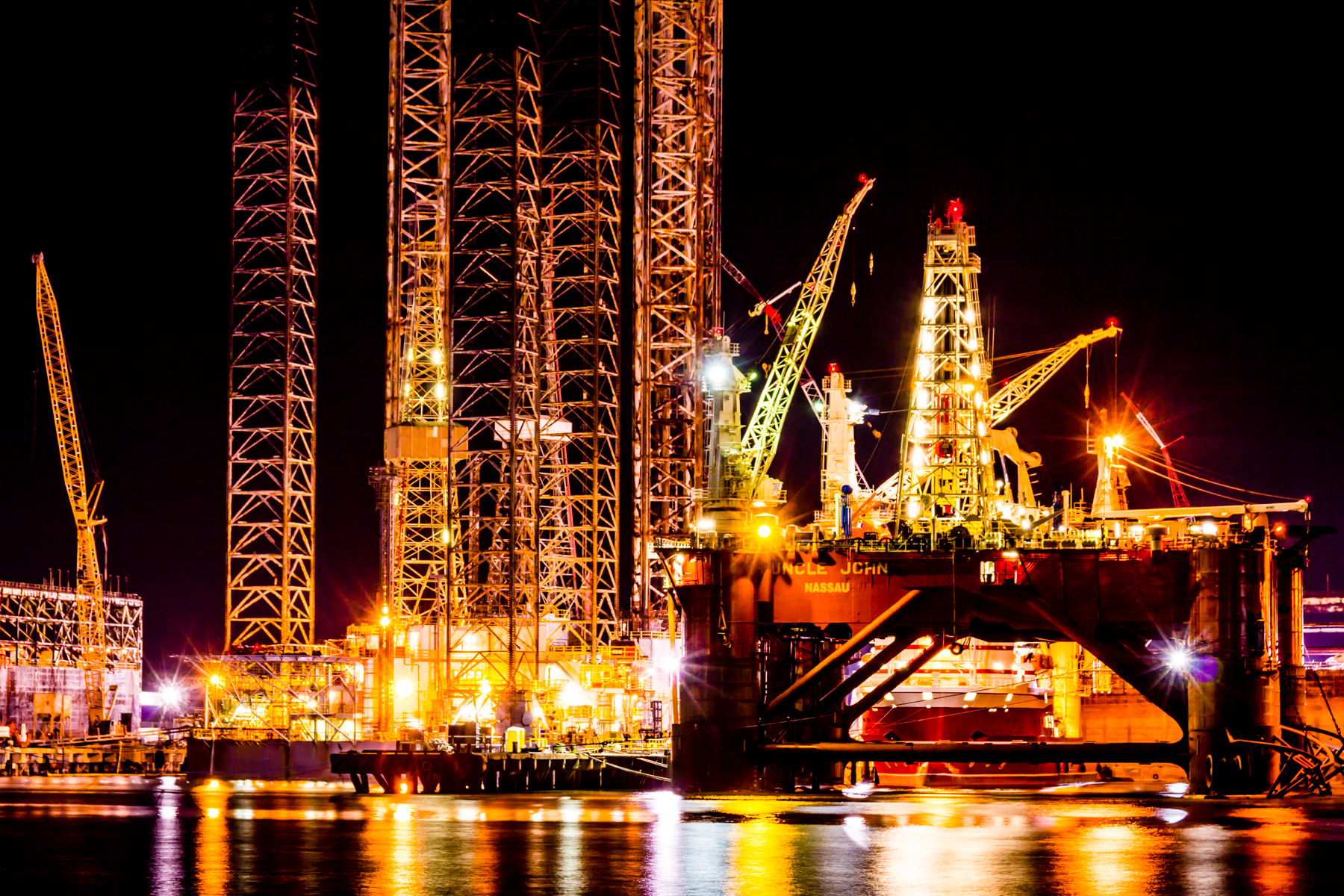 Offshore oil platforms in graving docks at Pelican Island, Galveston, Texas.