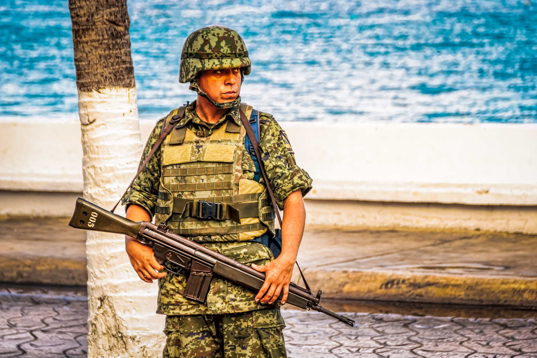A soldier keeps watch in San Miguel, Cozumel, Mexico.