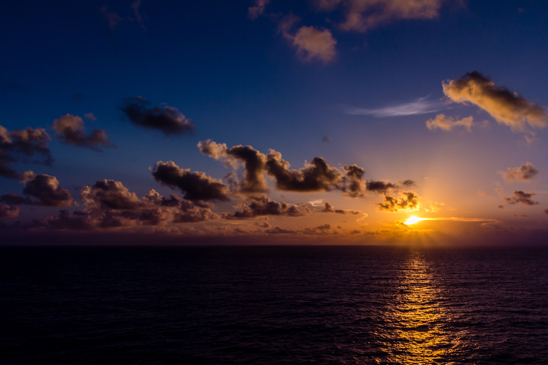 The sun rises over the Gulf of Mexico, as seen from the deck of the cruise ship Carnival Triumph.