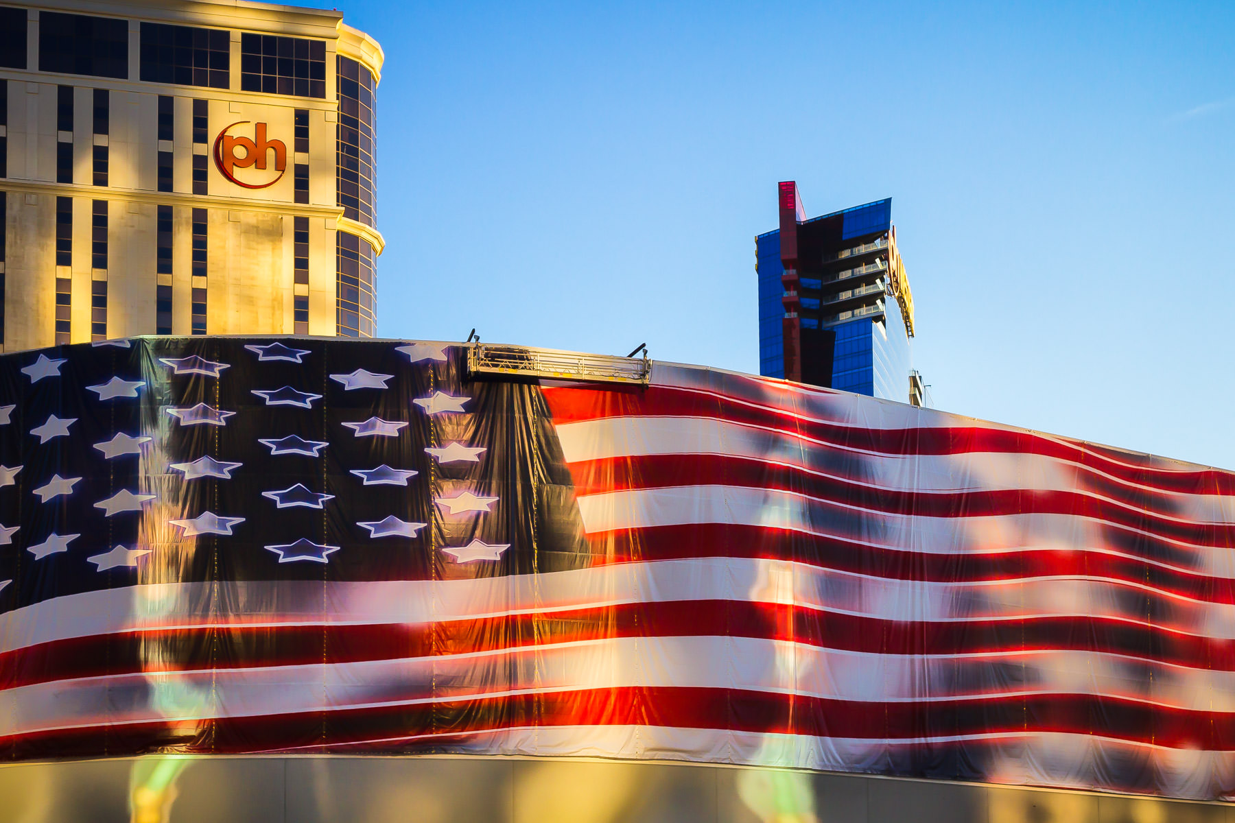 A giant construction tarp printed with the American flag, Las Vegas.