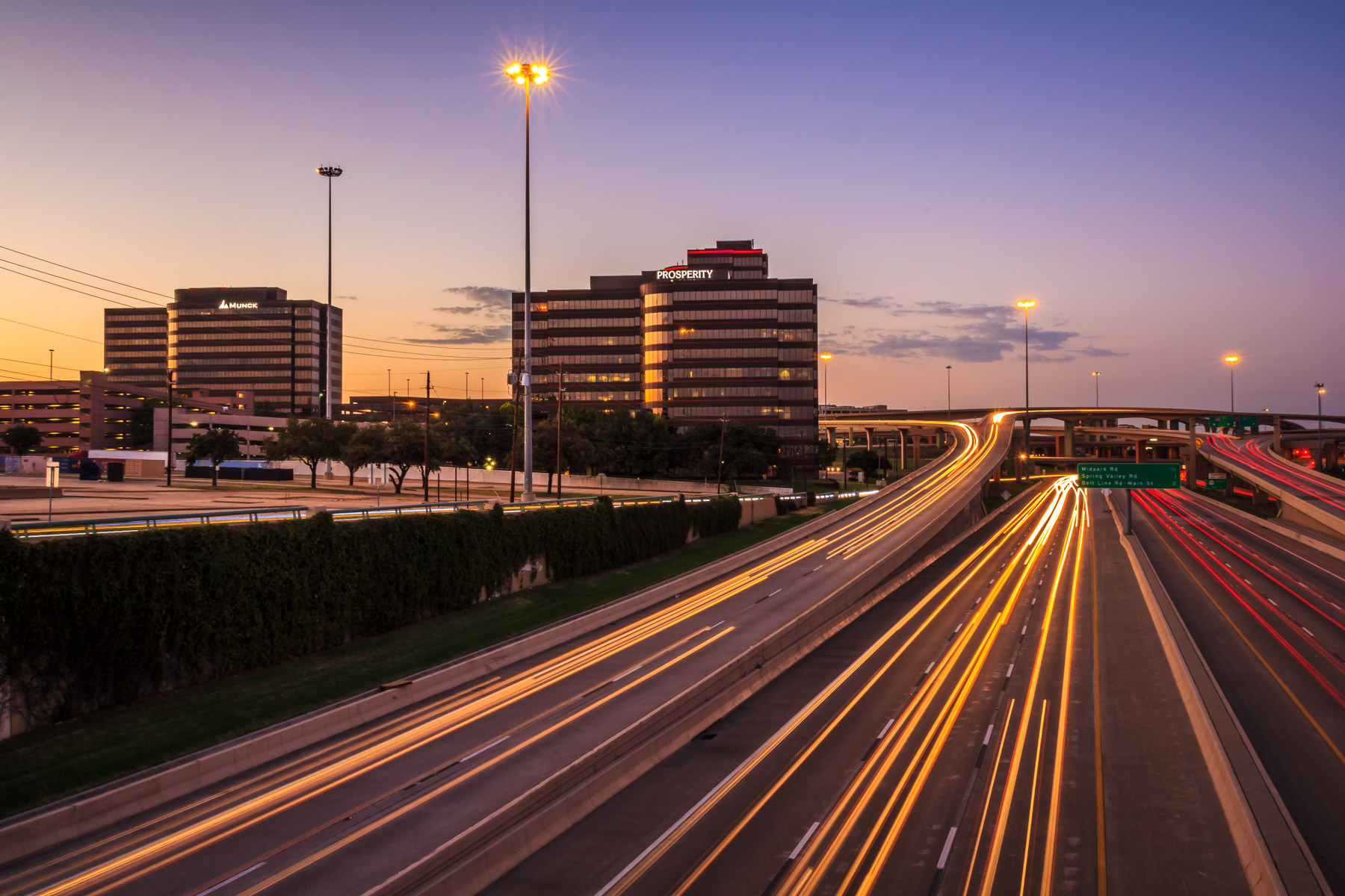 Light trails from Dallas' I-635 and US 75 interchange.