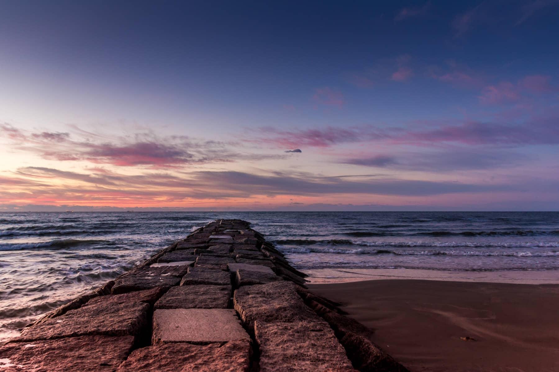 The sun rises over the Gulf of Mexico east of Galveston Island, Texas.
