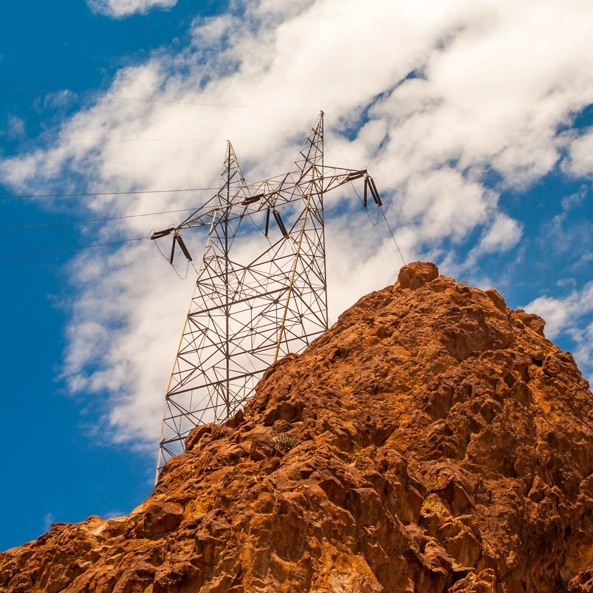 A power line pylon perched atop a rocky outcropping near Hoover Dam, on the Nevada/Arizona border.