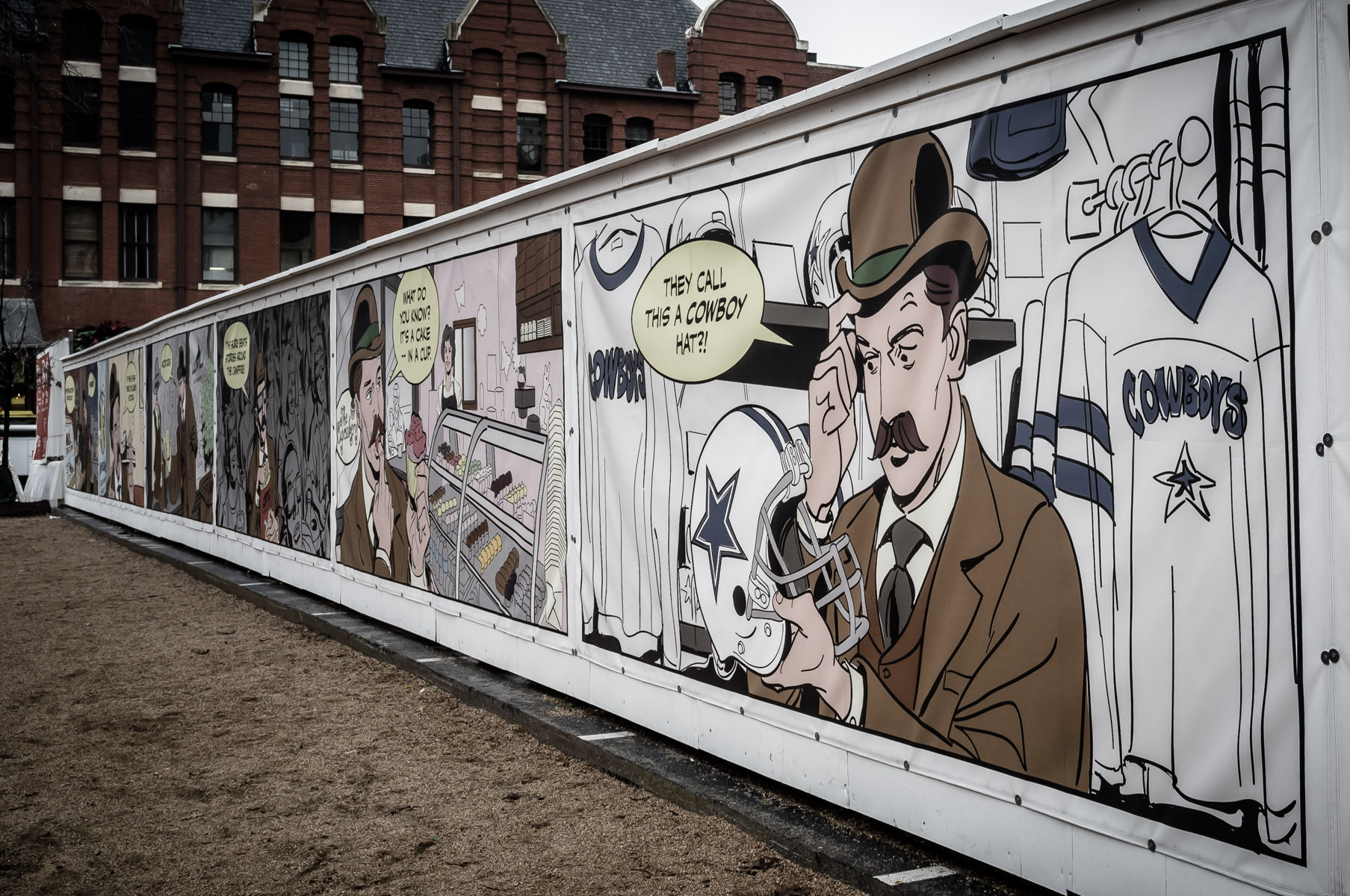 A stylized comic strip printed on a construction wall, spotted in Fort Worth, Texas.