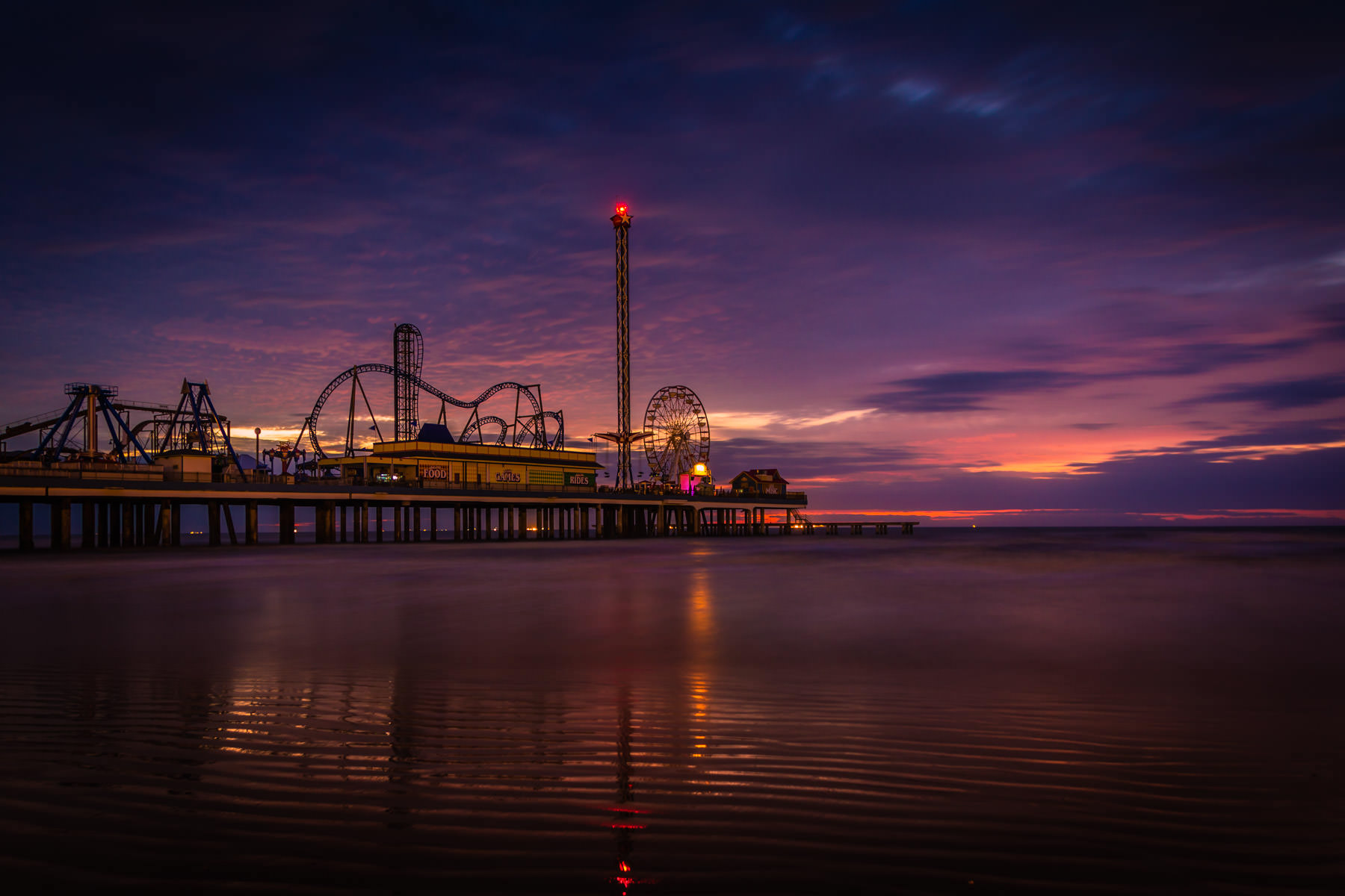 A fifteen-second pre-dawn exposure of Galveston, Texas' Pleasure Pier.