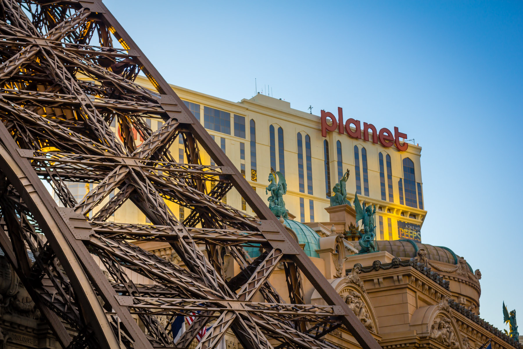 Exterior detail of Paris Hotel & Casino, with Planet Hollywood in the background, Las Vegas.