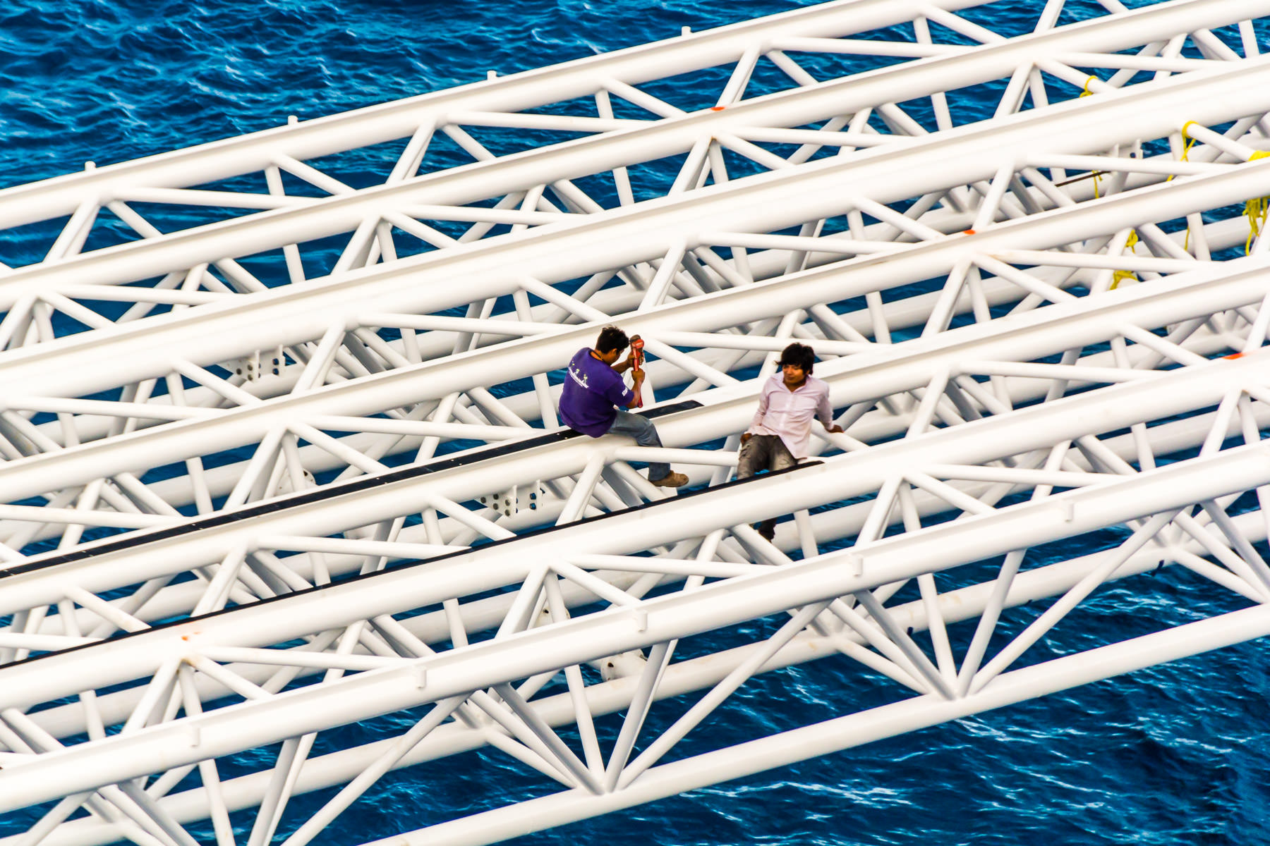 Workers on a dock structure in Cozumel, Mexico.