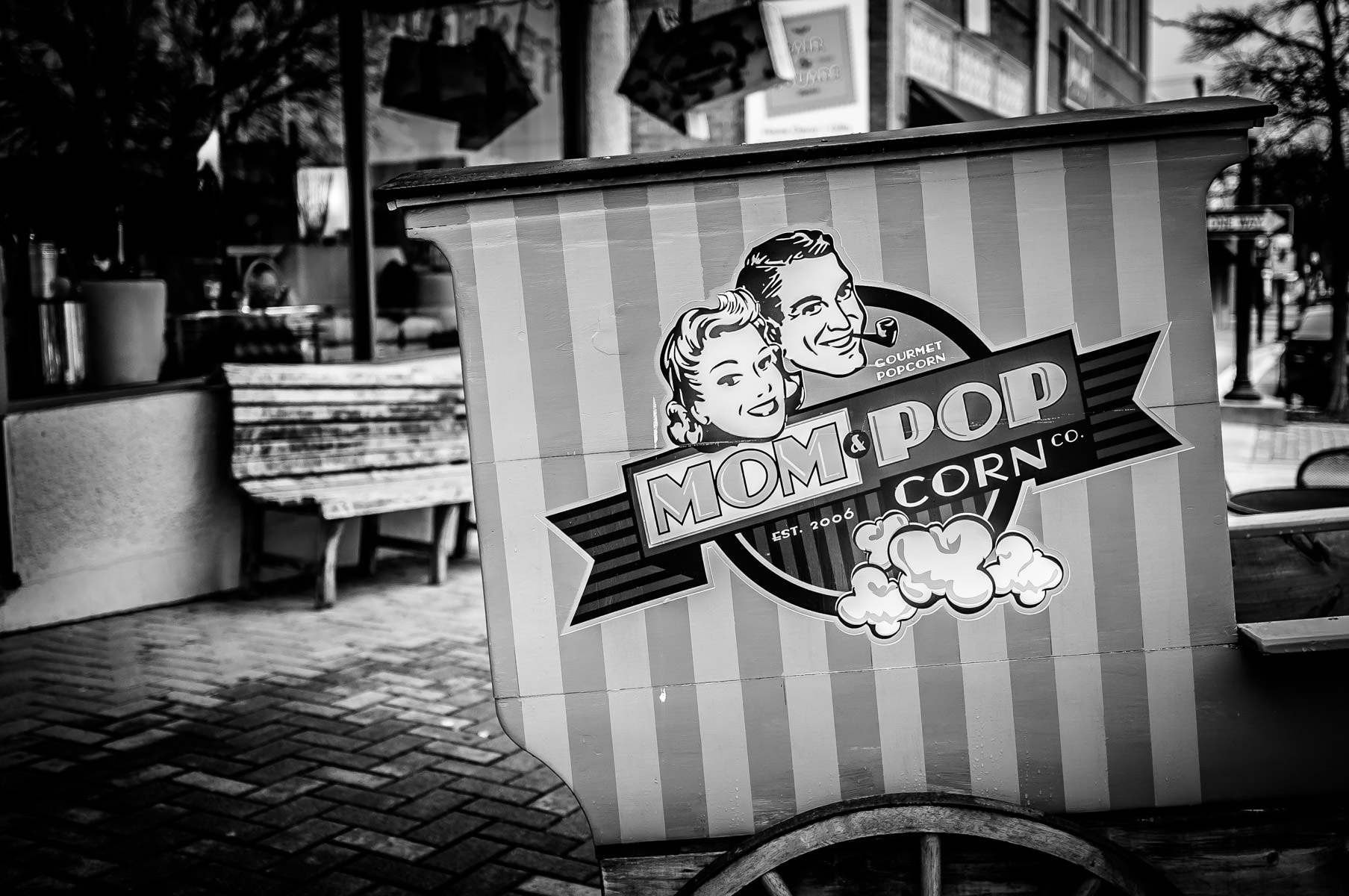 A cart advertising a local specialty popcorn shop in Downtown McKinney, Texas.