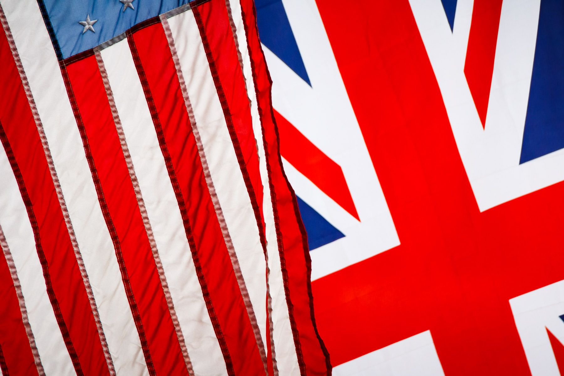 United States and British flags hanging outside of a pub in McKinney, Texas.