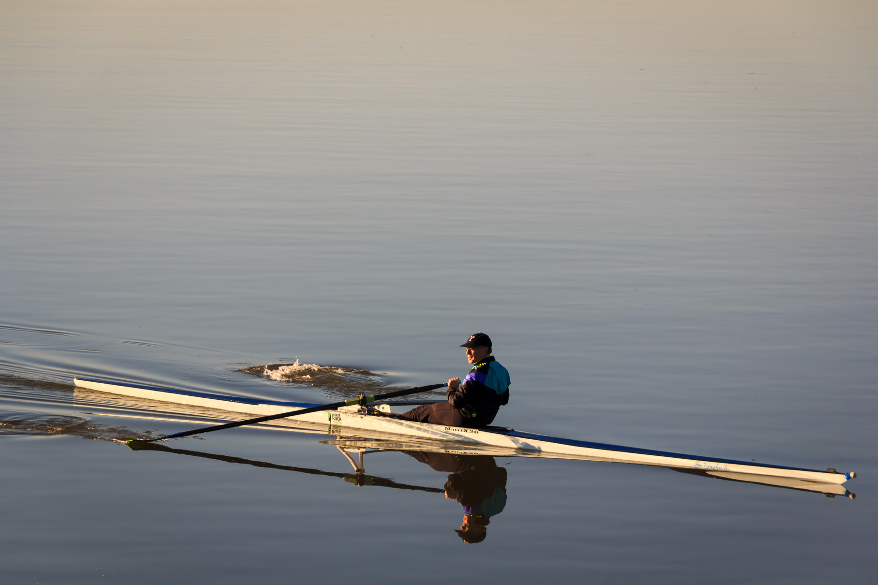 A rower glides across Dallas' White Rock Lake just after dawn on a winter morning.