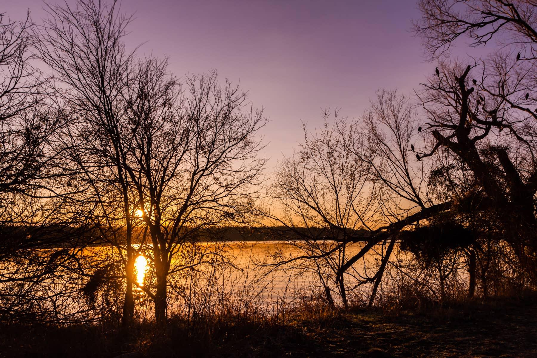 The sun rises over White Rock Lake, Dallas.