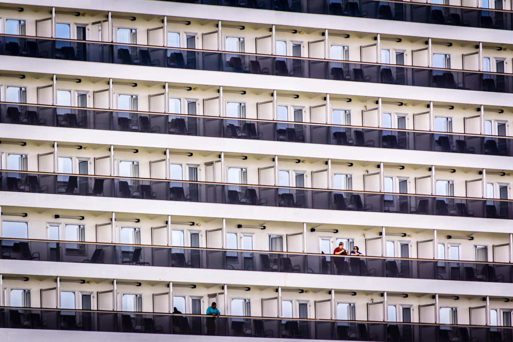 Vacationers aboard the Carnival Magic as she leaves the Port of Galveston, Texas.