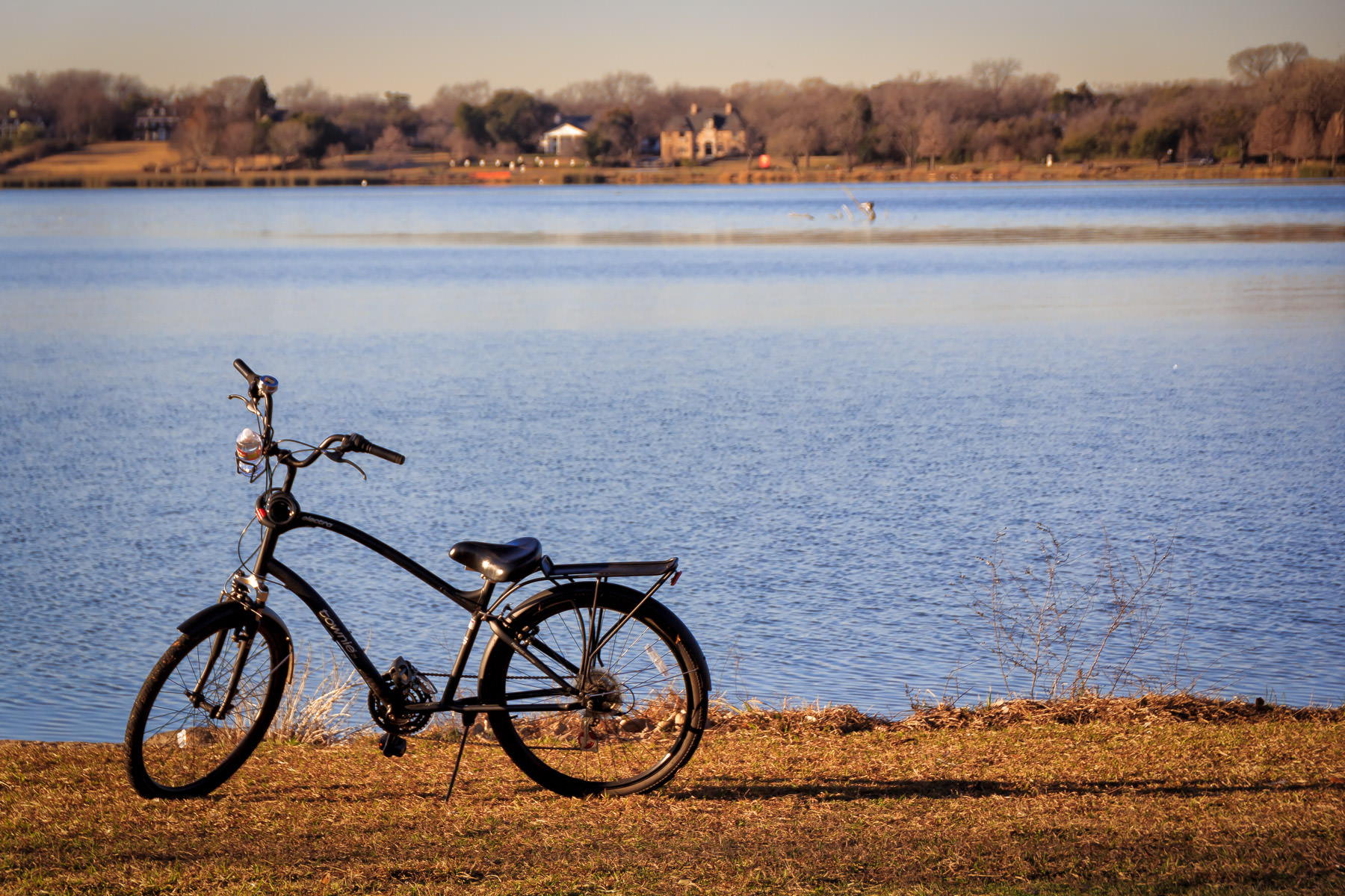 A bicycle parked along the shoreline at White Rock Lake, Dallas.