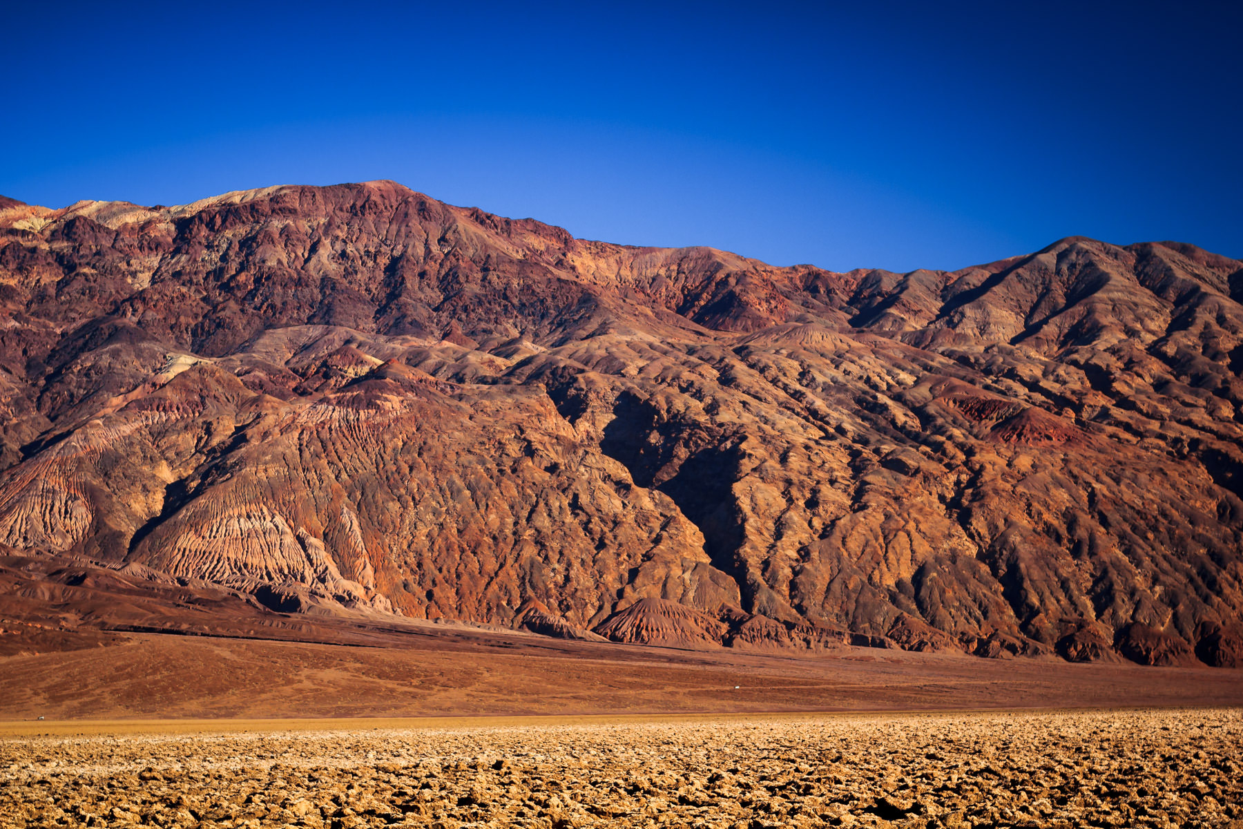 Mountains frame the desert landscape of Death Valley National Park, California.