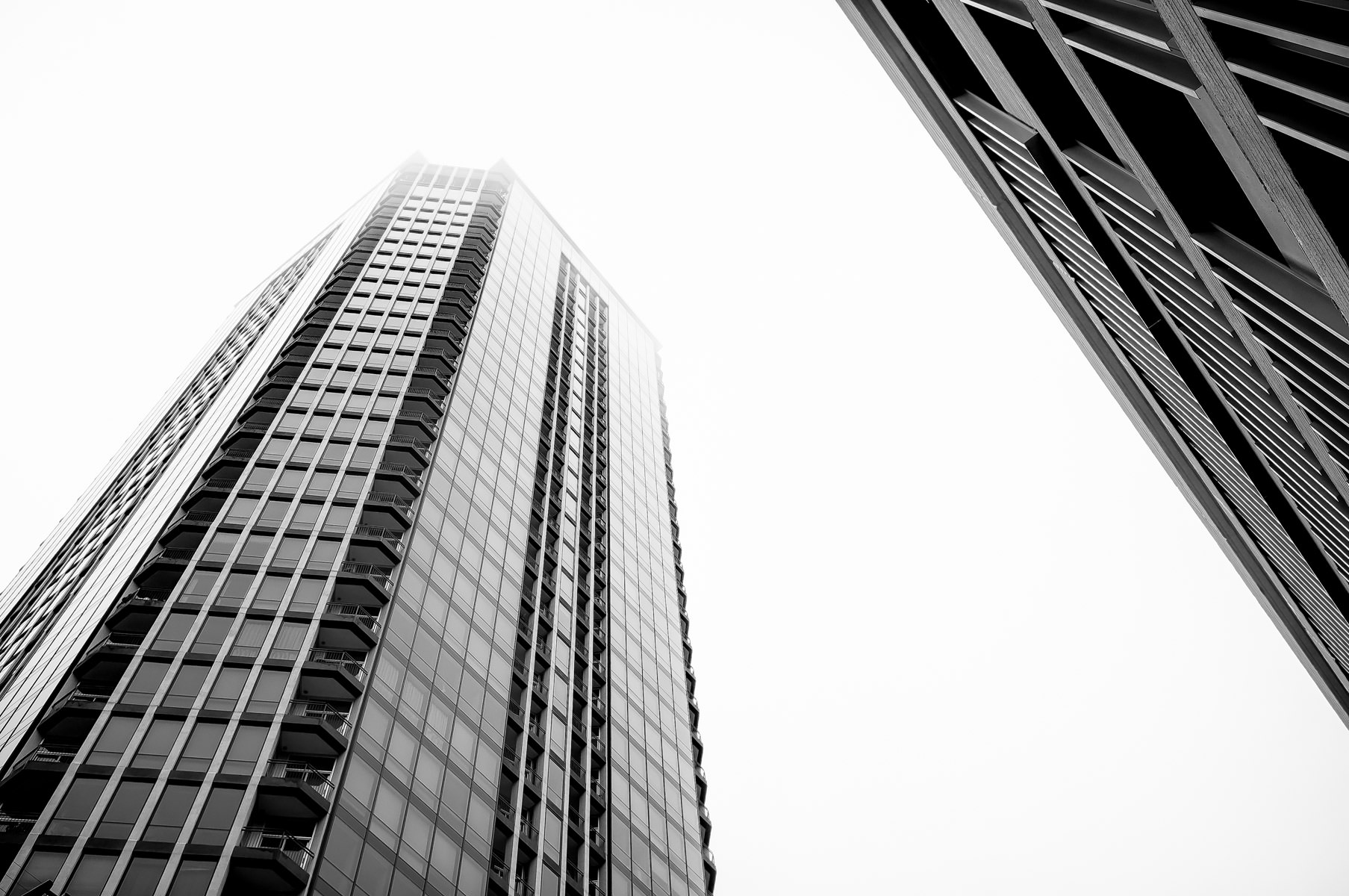 The Tower Condominiums rises into the clouds on a cold, rainy winter day in Downtown Fort Worth, Texas.