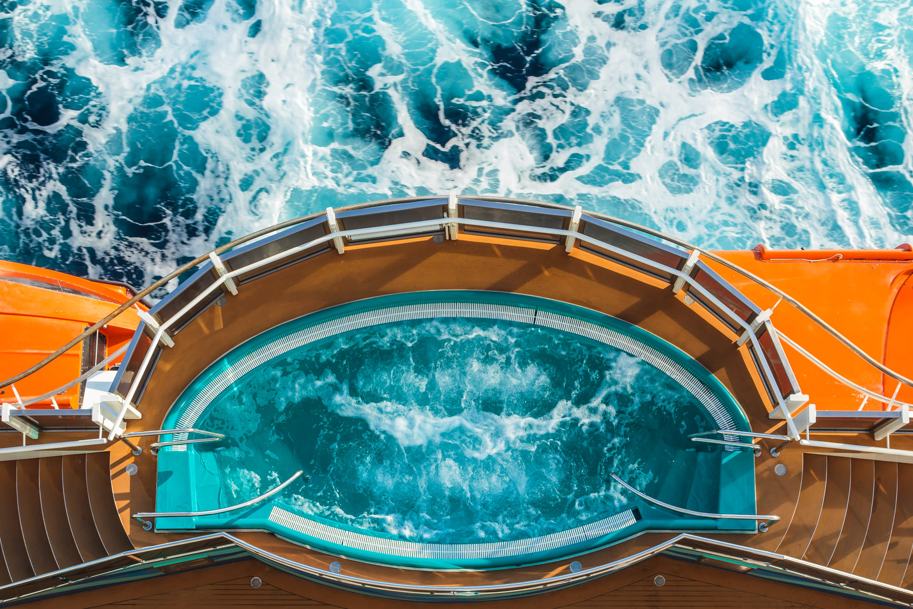 One of the four hot tubs that bulge out over the sea aboard the cruise ship Carnival Magic, as seen from above.