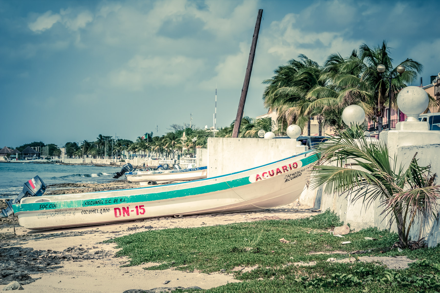 Boats beached along the Malecón in San Miguel, Cozumel. Mexico.