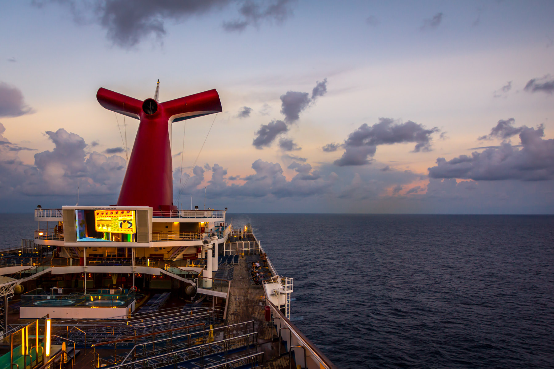Morning twilight lights the Carnival Triumph as she sails through the Gulf of Mexico.