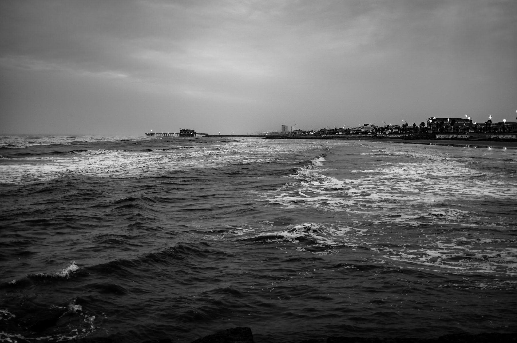 The Gulf of Mexico churns in the early dawn hours just off the coast of Galveston, Texas.