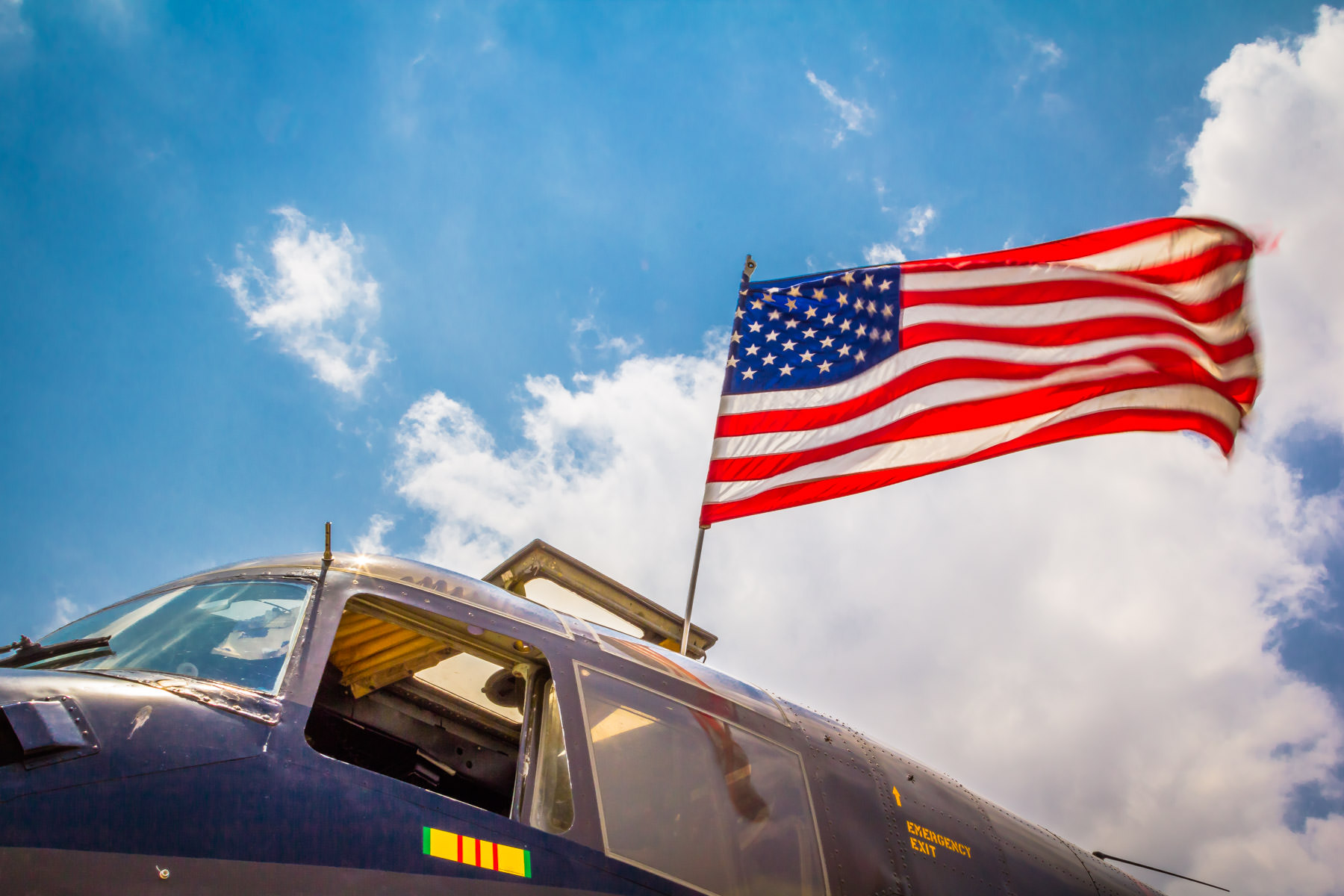An American flag flies on an U.S. Army de Havilland Canada DHC-4 Caribou at the Cavanaugh Flight Museum, Addison, Texas.