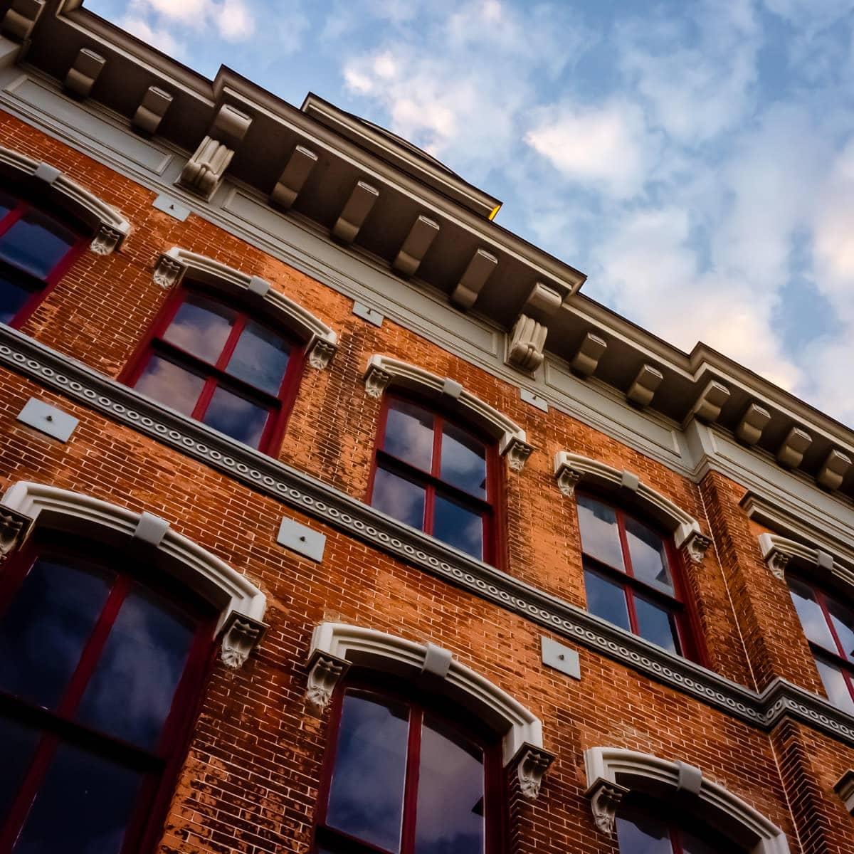 Detail of the façade of a historic building along Galveston, Texas' Victorian-era Strand Historic District.