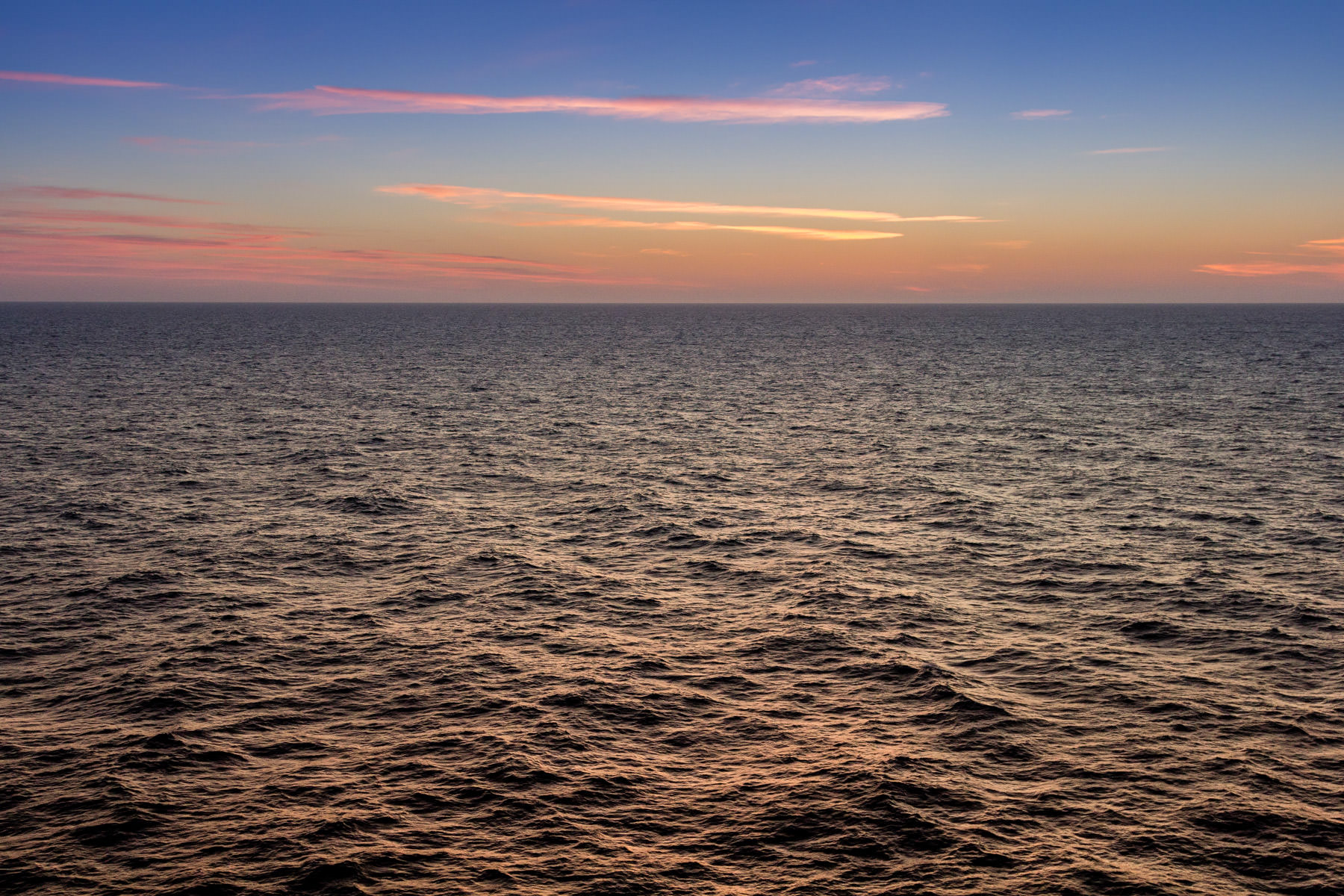 The sun rises on the Gulf of Mexico, somewhere roughly midway between the Texas Gulf Coast and Cuba, as seen from the deck of the cruise ship Carnival Magic.