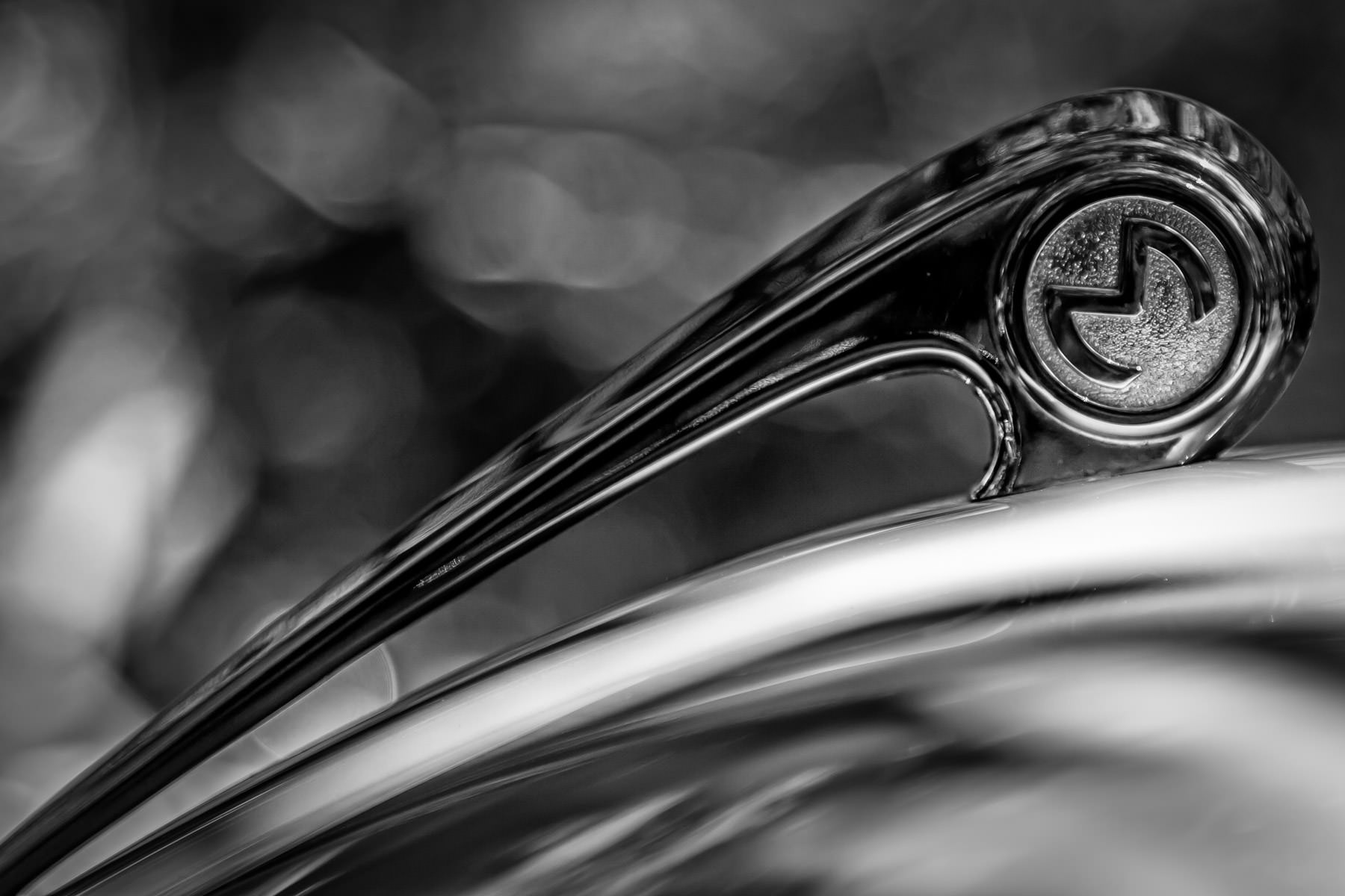 The hood ornament of a classic Morris Minor as seen at Dallas' Autos in the Park at Cooper Aerobics Center.