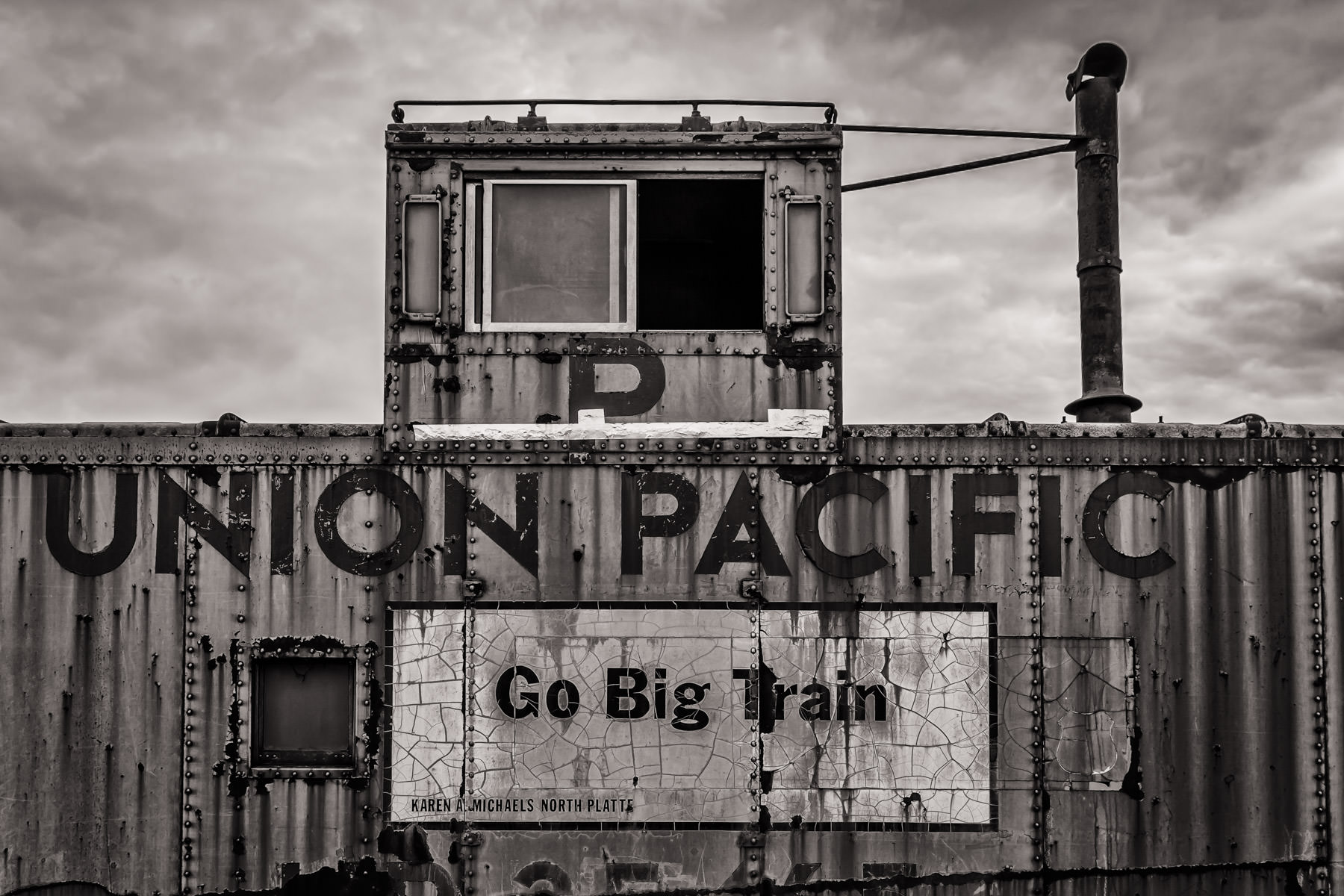 A dilapidated Union Pacific caboose found in Grapevine, Texas in the collection of the Grapevine Vintage Railroad.