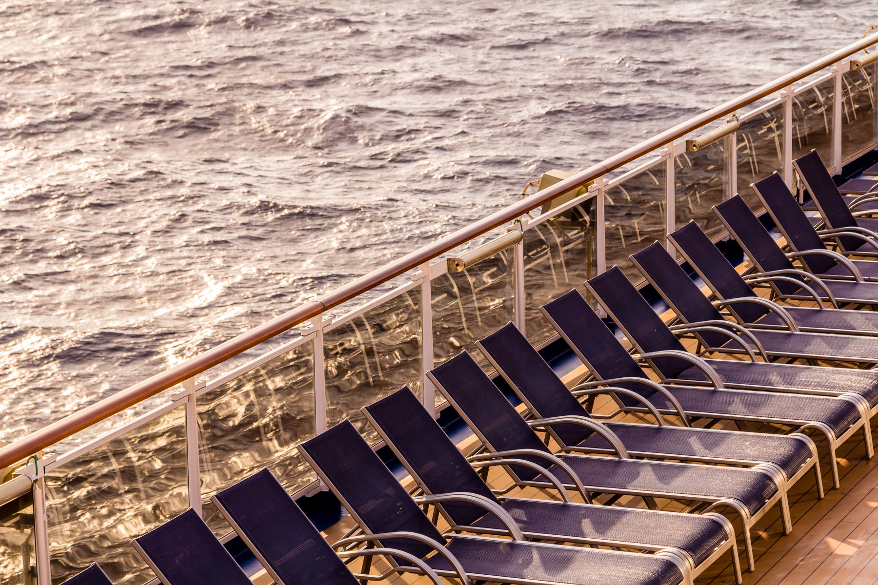 Lounge chairs greet the morning sun aboard the cruise ship Carnival Magic, somewhere in the Gulf of Mexico.