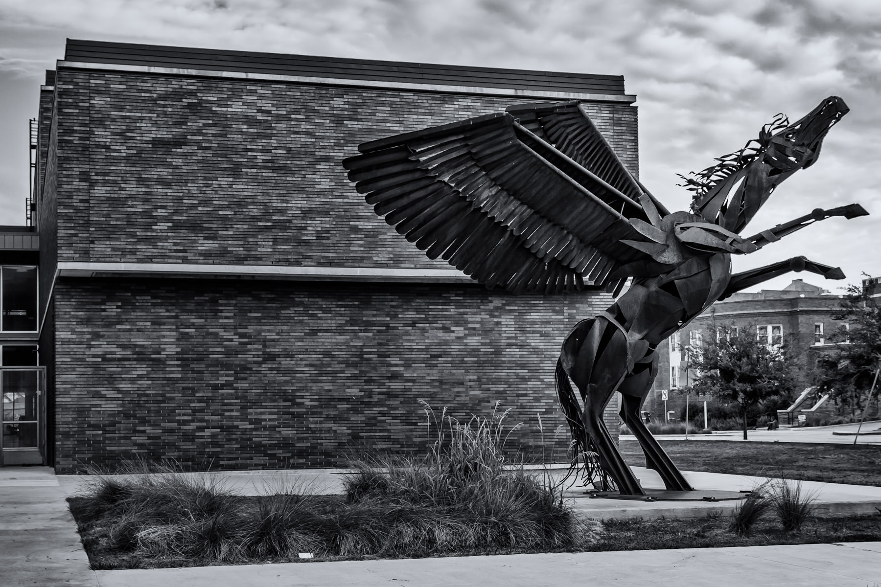 An abstract sculpture of Pegasus outside of the Dallas Arts District's Booker T. Washington High School for the Performing and Visual Arts.