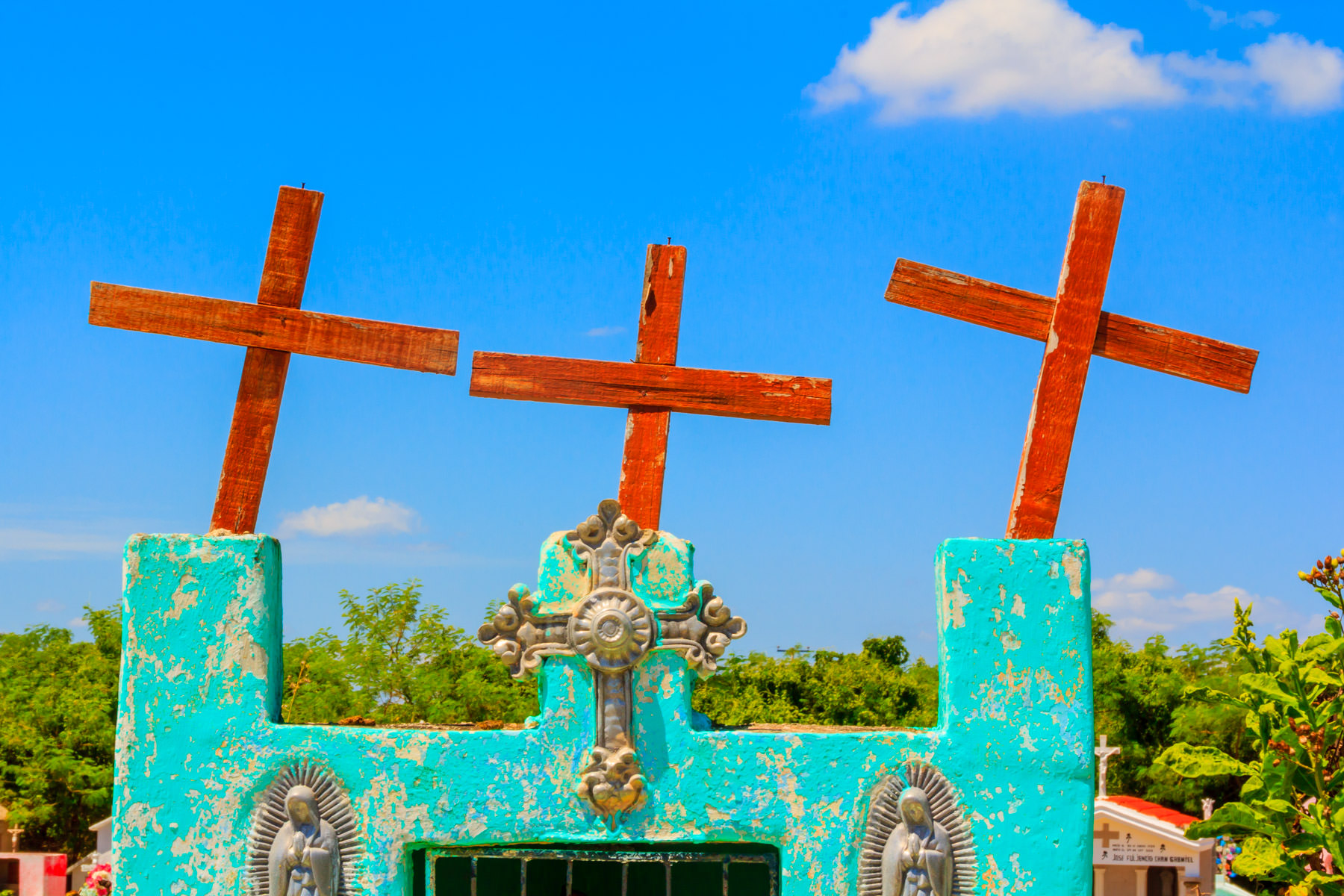 Crosses atop a colorful grave at a cemetery in the tiny Mayan town of Dzemul, Yucatan, Mexico.