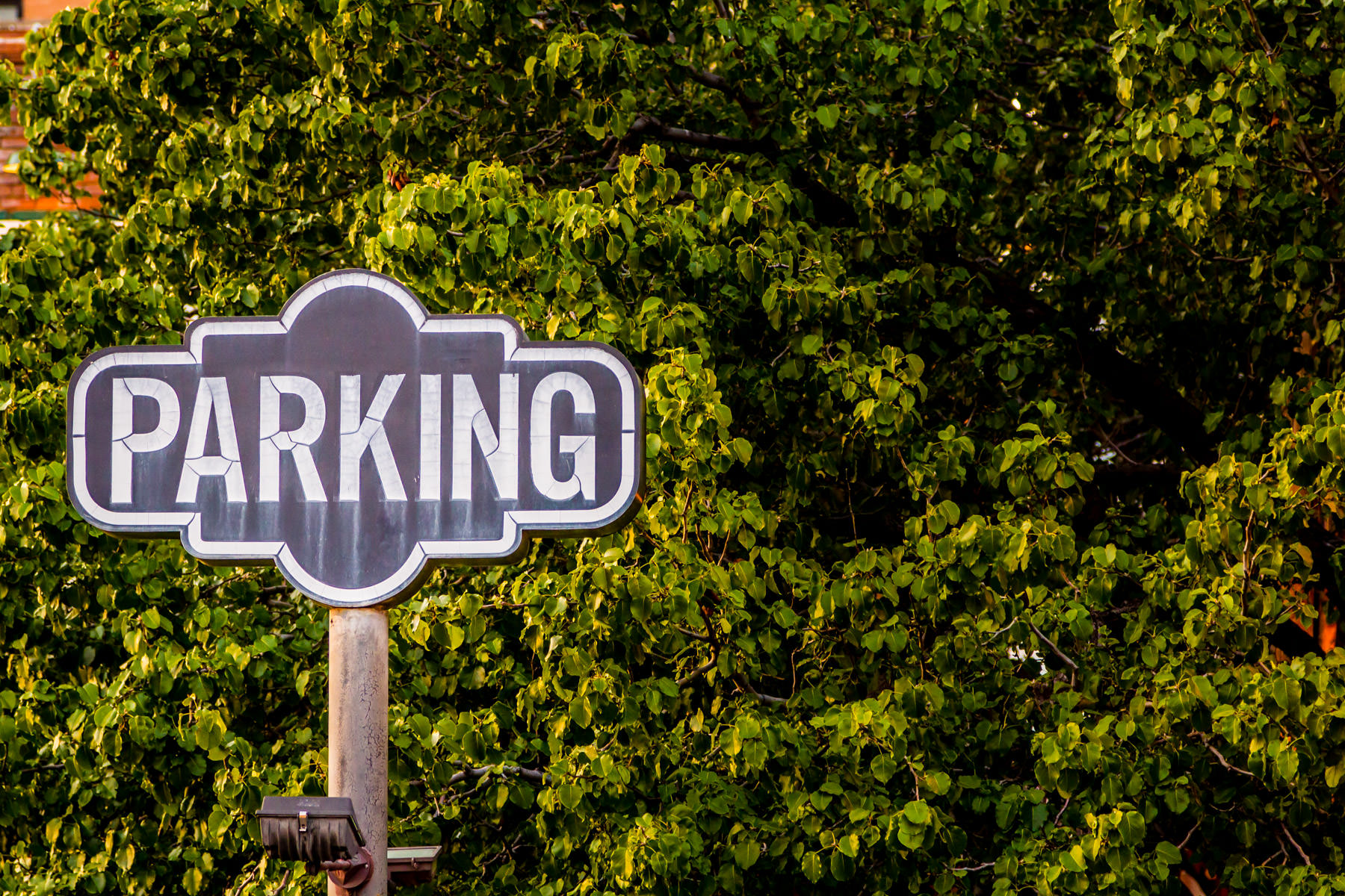 A sign advertising parking in Dallas' West End district.