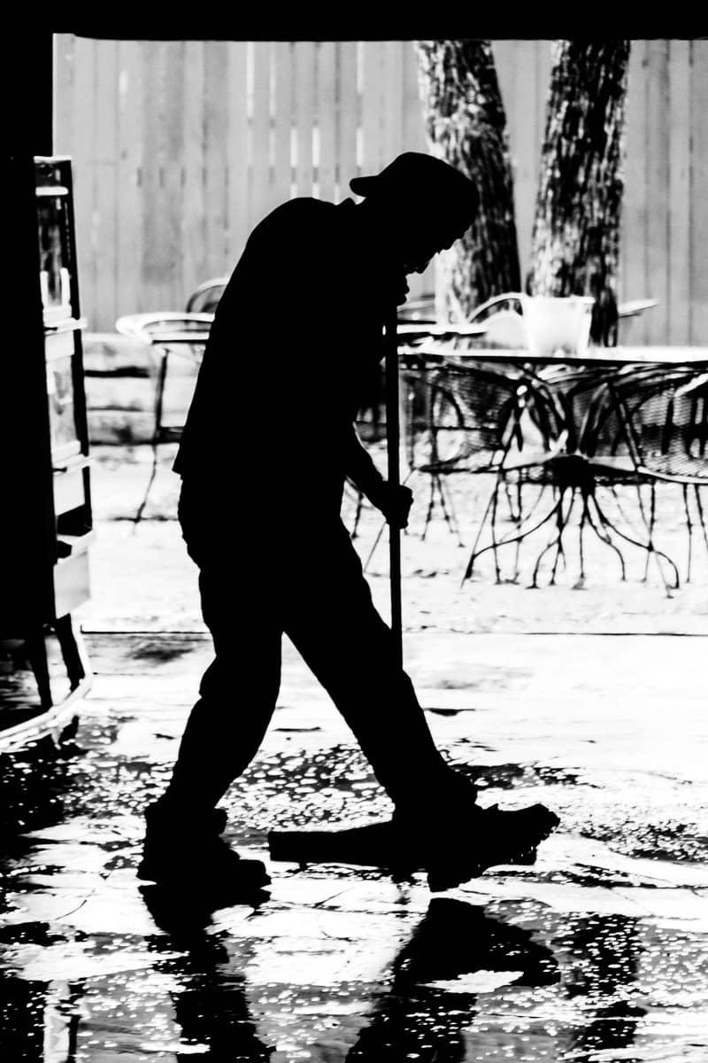 A worker cleans the floor of a nightclub in Dallas' Deep Ellum neighborhood.