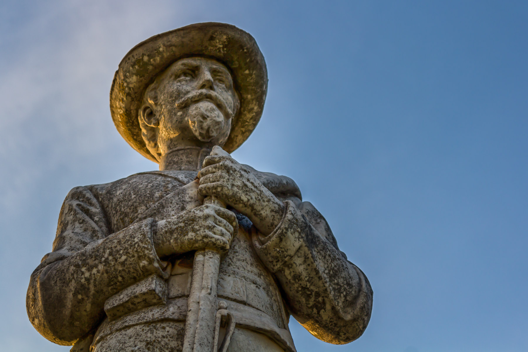A carved stone Confederate soldier watched over the Confederate Soldiers Monument, Oakwood Cemetery, Tyler, Texas.
