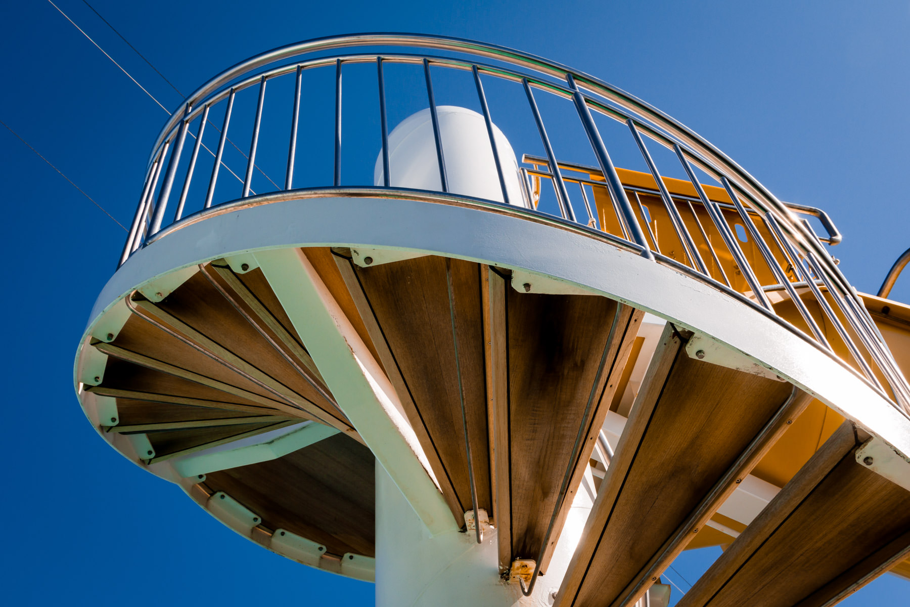 A spiral staircase leading to the top of a water slide aboard the cruise shipNorwegian Pearl.