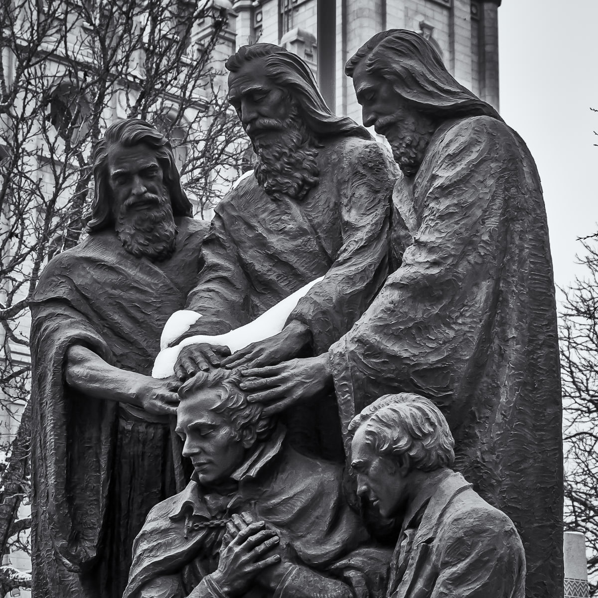 A bronze statue in Salt Lake City, Utah's Temple Square depicting Peter, James and John in the act of conferring the Melchizedek priesthood to Joseph Smith and Oliver Cowdery, founders of the Latter Day Saints movement.