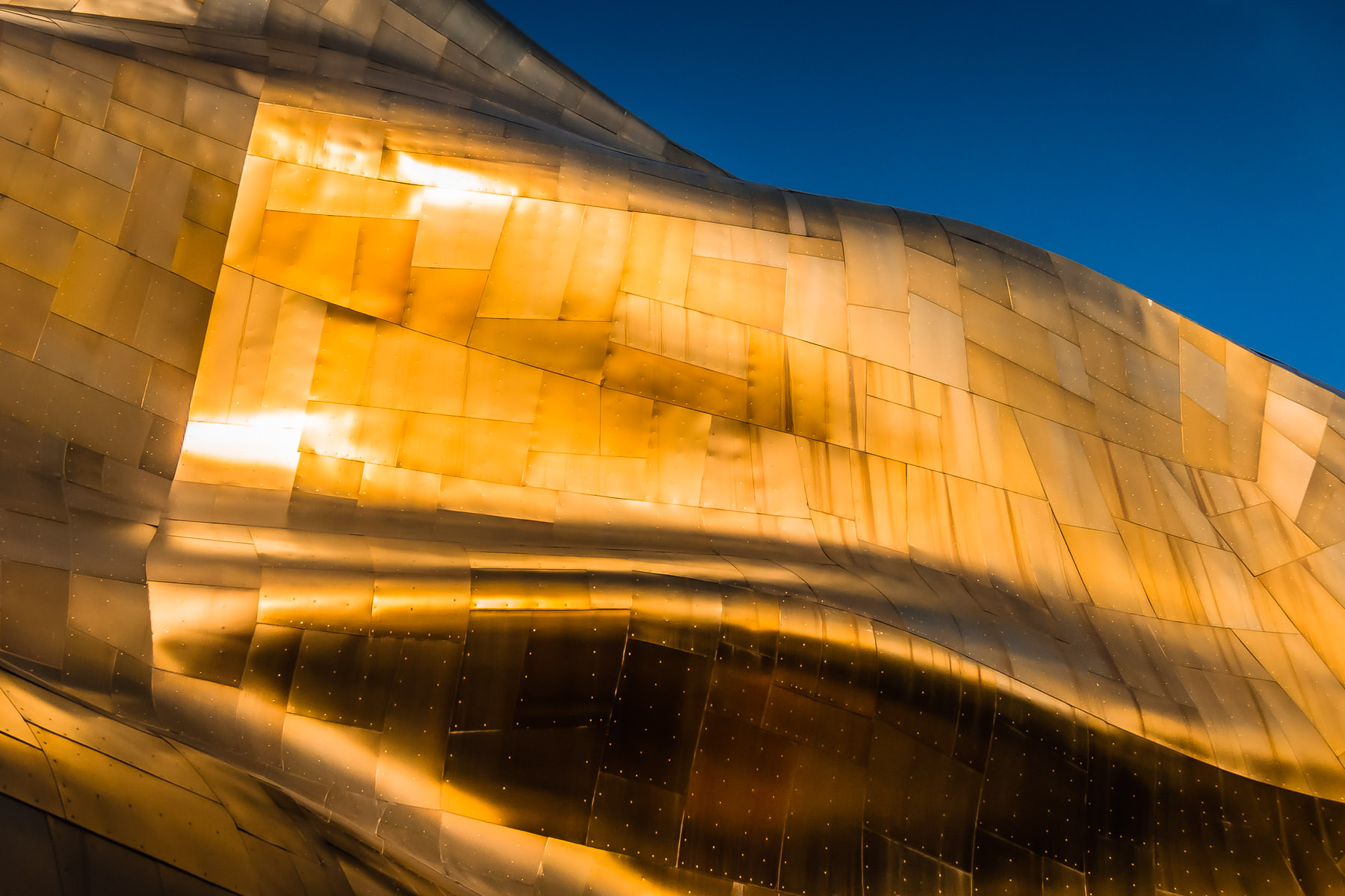 The early-morning sun lights the organic curves of the stainless steel roof of architect Frank Gehry's Experience Music Project in Seattle, Washington.