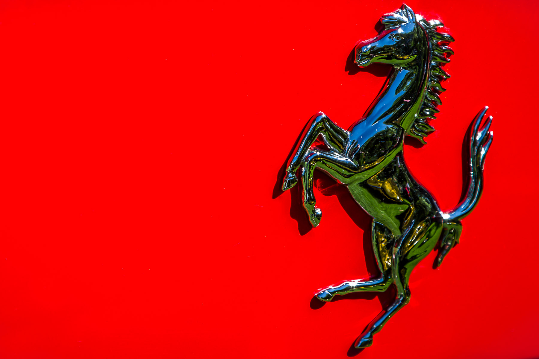 Ferrari's iconic Prancing Stallion, or Cavallino Rampante, as seen on a Ferrari F12 Berlinetta at Dallas' Cooper Aerobics Center's Autos in the Park event.
