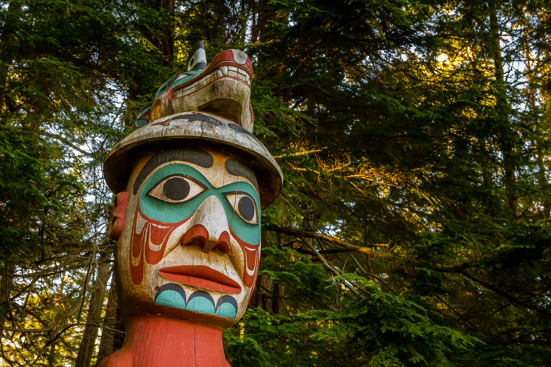 "A totem pole titled ""Man Wearing Bear Hat"" at Ketchikan, Alaska's Totem Bight State Park."